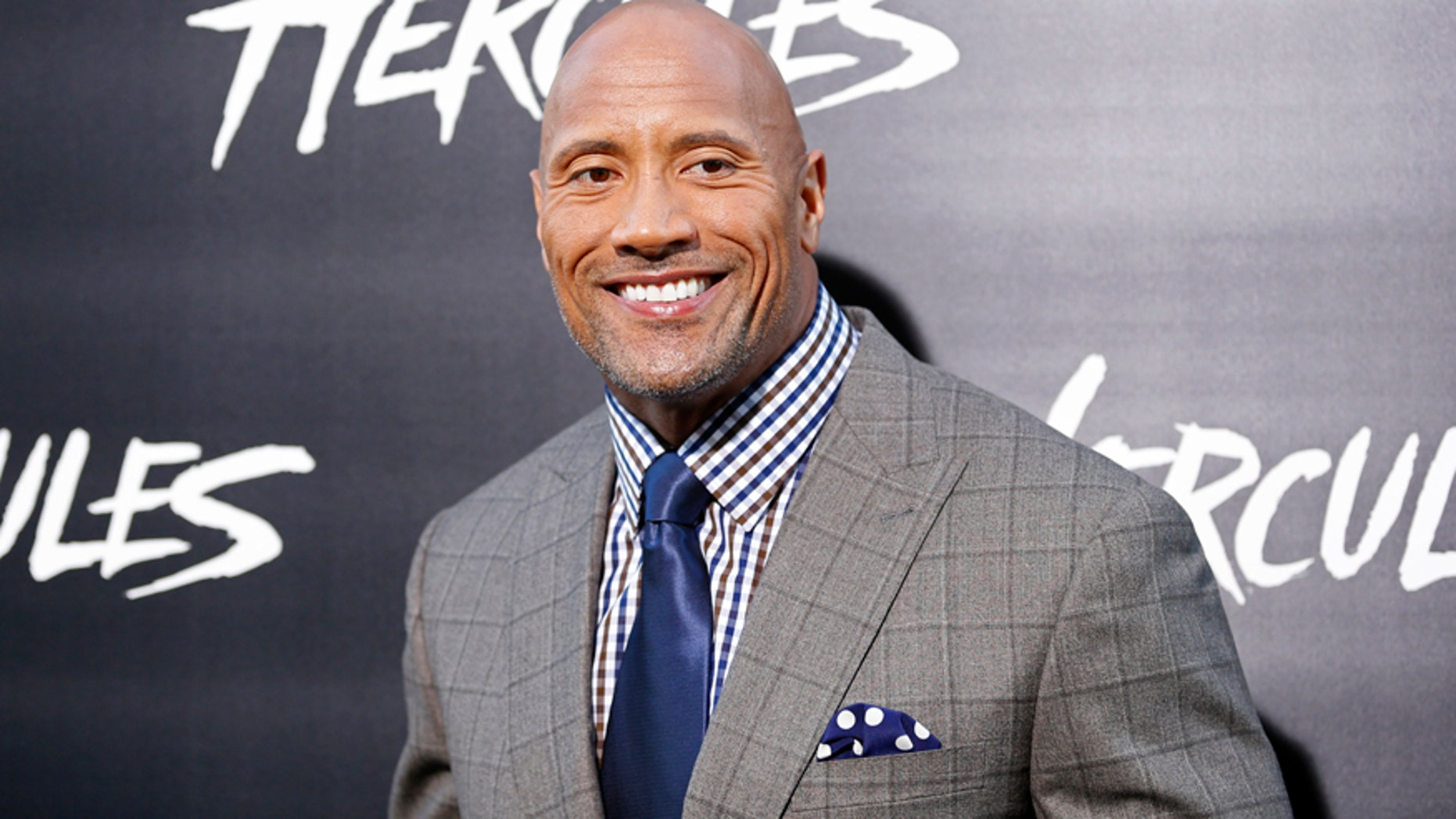 "Cast member Dwayne Johnson poses at the Los Angeles premiere of ""Hercules"" in Hollywood, California July 23, 2014."