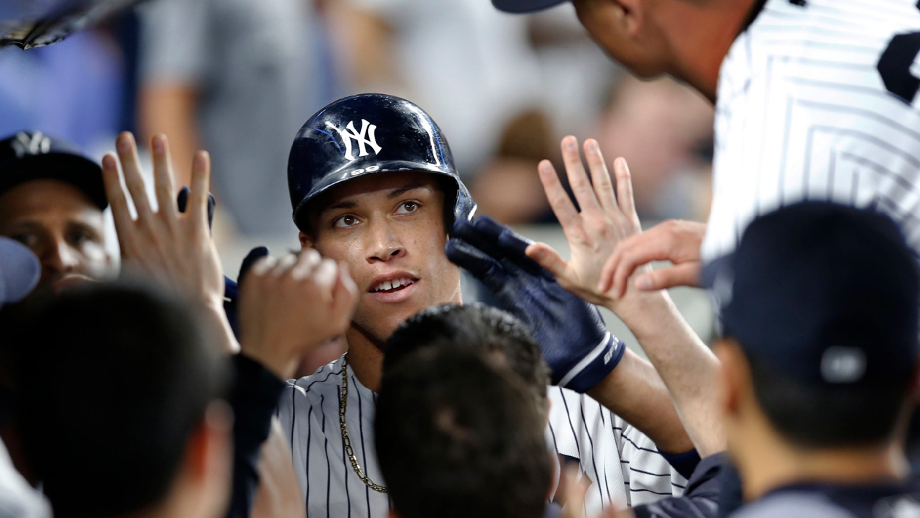 July 7: New York Yankees' Aaron Judge, center, is congratulated after his fifth-inning home run against the Milwaukee Brewers in a baseball game in in New York.
