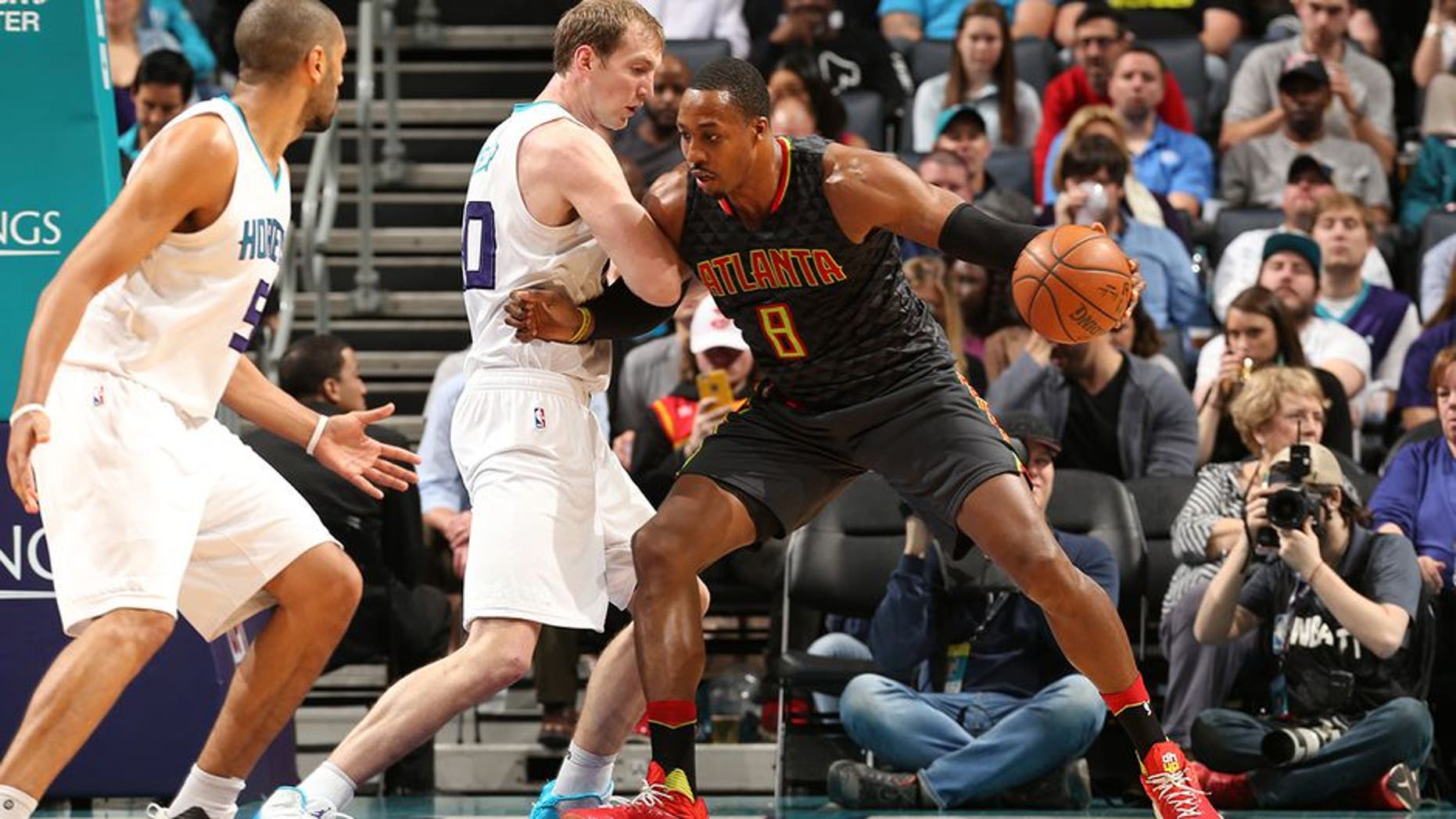 CHARLOTTE, NC - MARCH 20: Dwight Howard #8 of the Atlanta Hawks handles the ball during a game against the Charlotte Hornets on March 20, 2017 at Spectrum Center in Charlotte, North Carolina. NOTE TO USER: User expressly acknowledges and agrees that, by downloading and/or using this photograph, user is consenting to the terms and conditions of the Getty Images License Agreement. Mandatory Copyright Notice: Copyright 2017 NBAE (Photo by Kent Smith/NBAE via Getty Images)