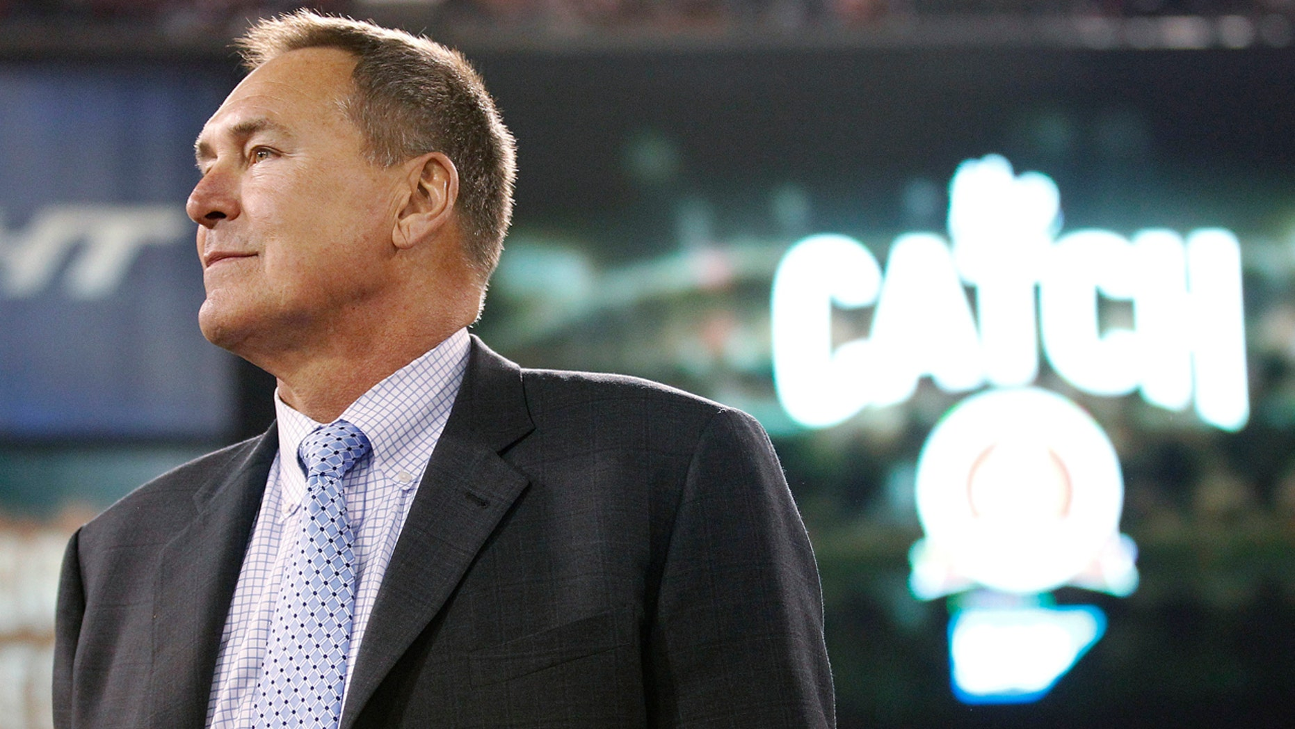 Dec. 23, 2013: In this file photo, former San Francisco 49ers wide receiver Dwight Clark is honored at halftime of an NFL football game between the 49ers and the Atlanta Falcons in San Francisco.