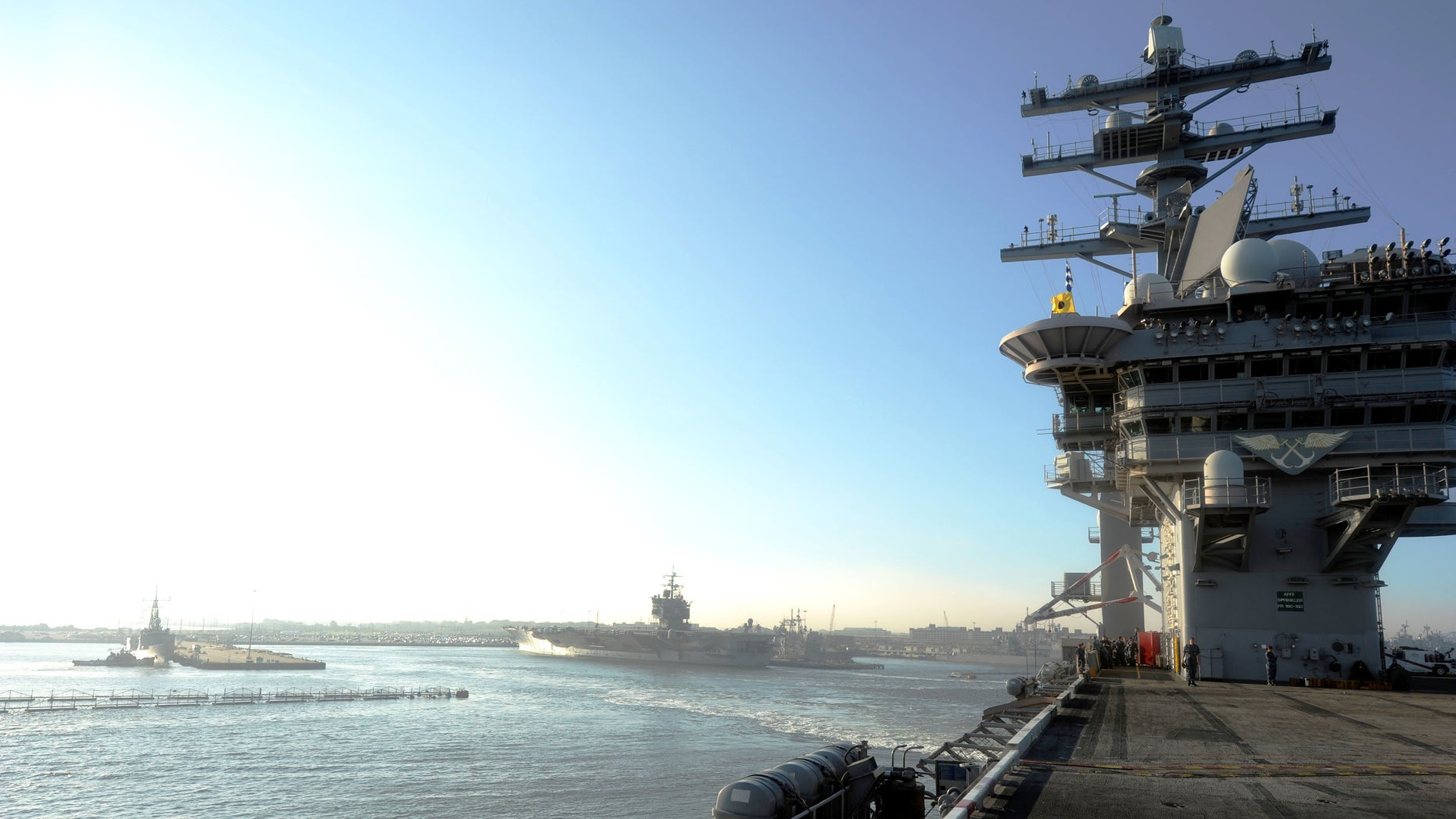 Aug. 25, 2011: The aircraft carrier USS Dwight D. Eisenhower departs Naval Station ahead of the possible landing of Hurricane Irene.