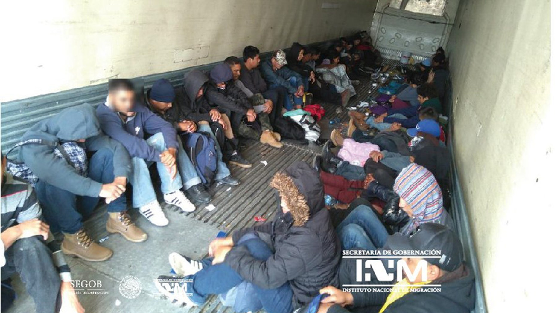 Mexican officials say they found 103 Central American migrants in a freight trailer abandoned near the U.S.-Mexico border.