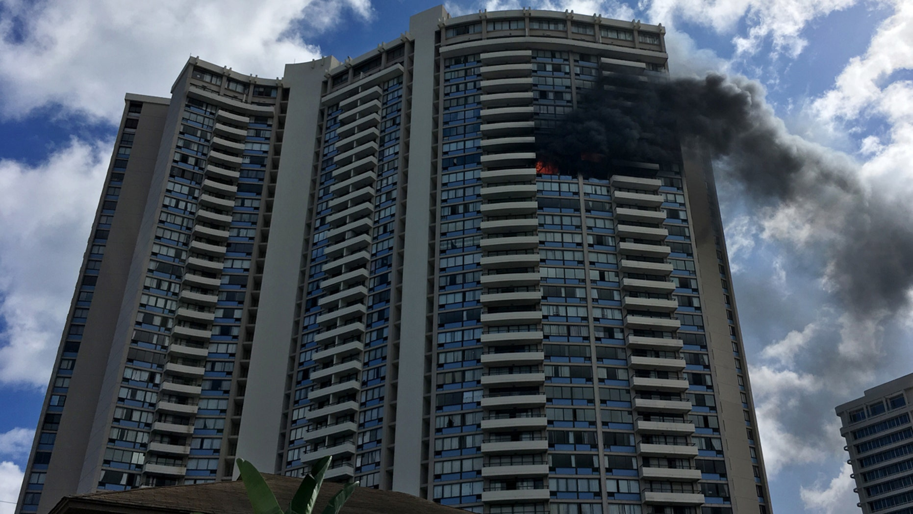 July 14: Smoke billows from a high-rise apartment building in Honolulu,