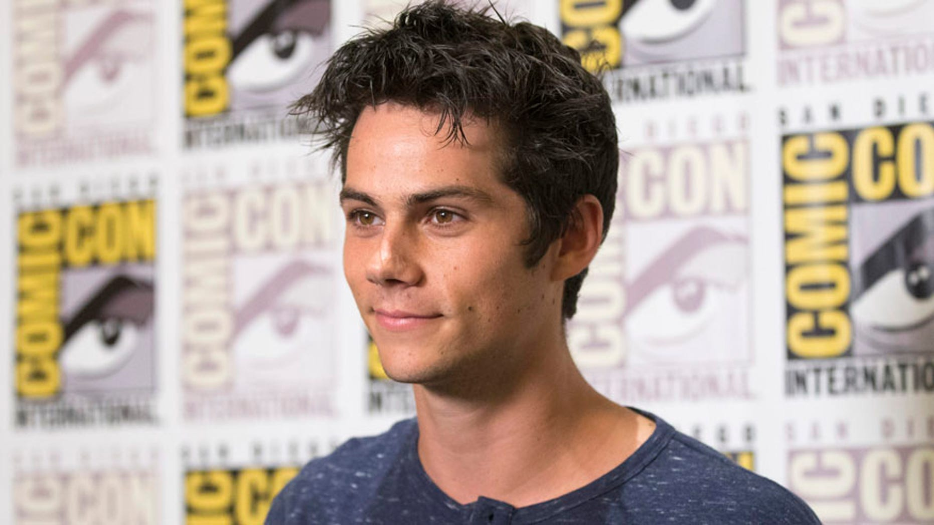 "Cast member Dylan O'Brien poses at a press line for ""The Maze Runner"" during the 2014 Comic-Con International Convention in San Diego, California July 25, 2014.  REUTERS/Mario Anzuoni (UNITED STATES - Tags: ENTERTAINMENT) - RTR406BA"