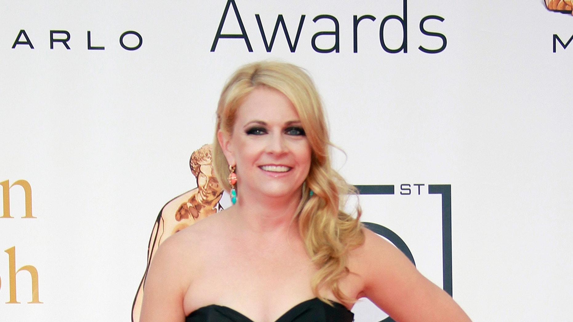 Actress Melissa Joan Hart arrives for the closing ceremony of the 51st Monte Carlo television festival in Monaco June 10, 2011.