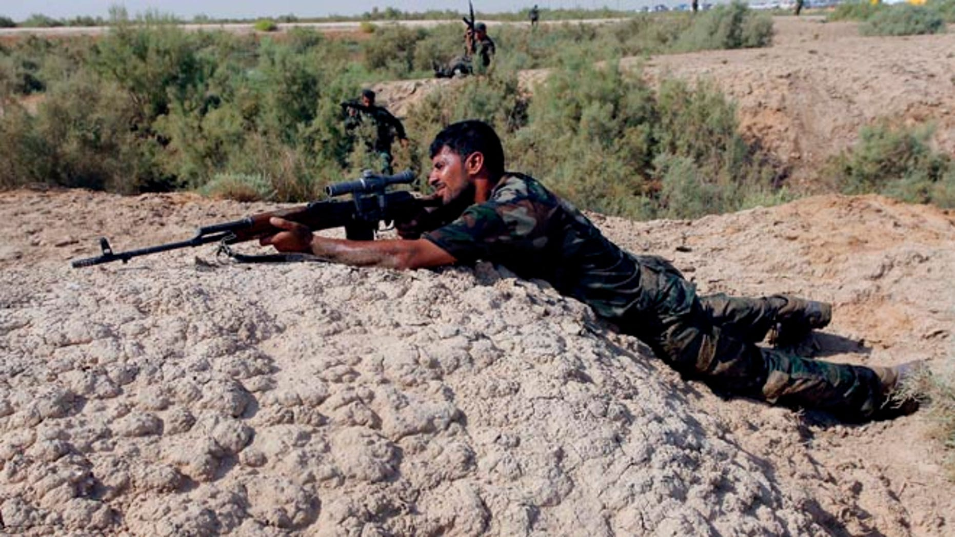 FILE: August 23, 2014: A Shite fighter, who has joined in the fight against Islamic State, taking part in field training in Najaf, Iraq.