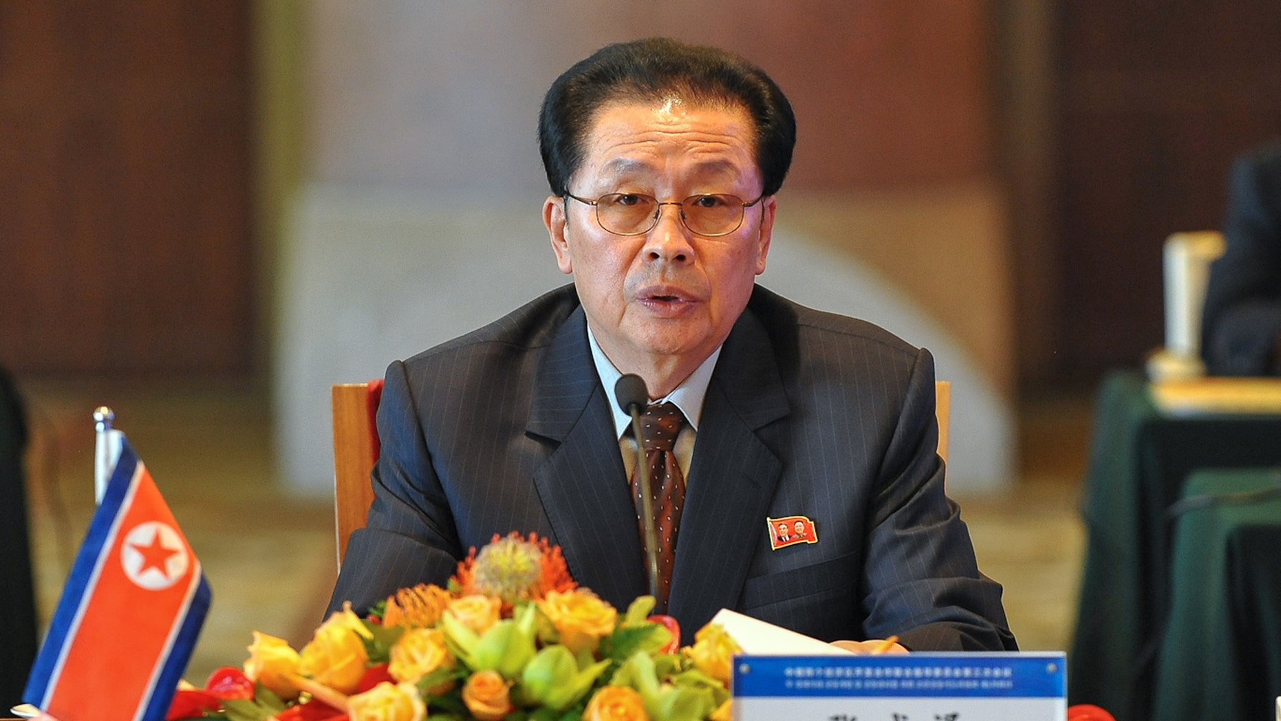 In this Tuesday, Aug. 14, 2012 file photo provided by China's Xinhua News Agency, Jang Song Thaek, North Korea's vice chairman of the powerful National Defense Commission, attends the third meeting on developing the economic zones in North Korea, in Beijing. Two South Korean lawmakers say they were told by intelligence officials that two associates of North Korean leader Kim Jong Un's powerful uncle Jang were executed last month. They say the uncle has not been seen in public since then and may have been dismissed. There was no way to independently confirm the report about Jang. (AP Photo/Xinhua, Li Xin, File)  NO SALES