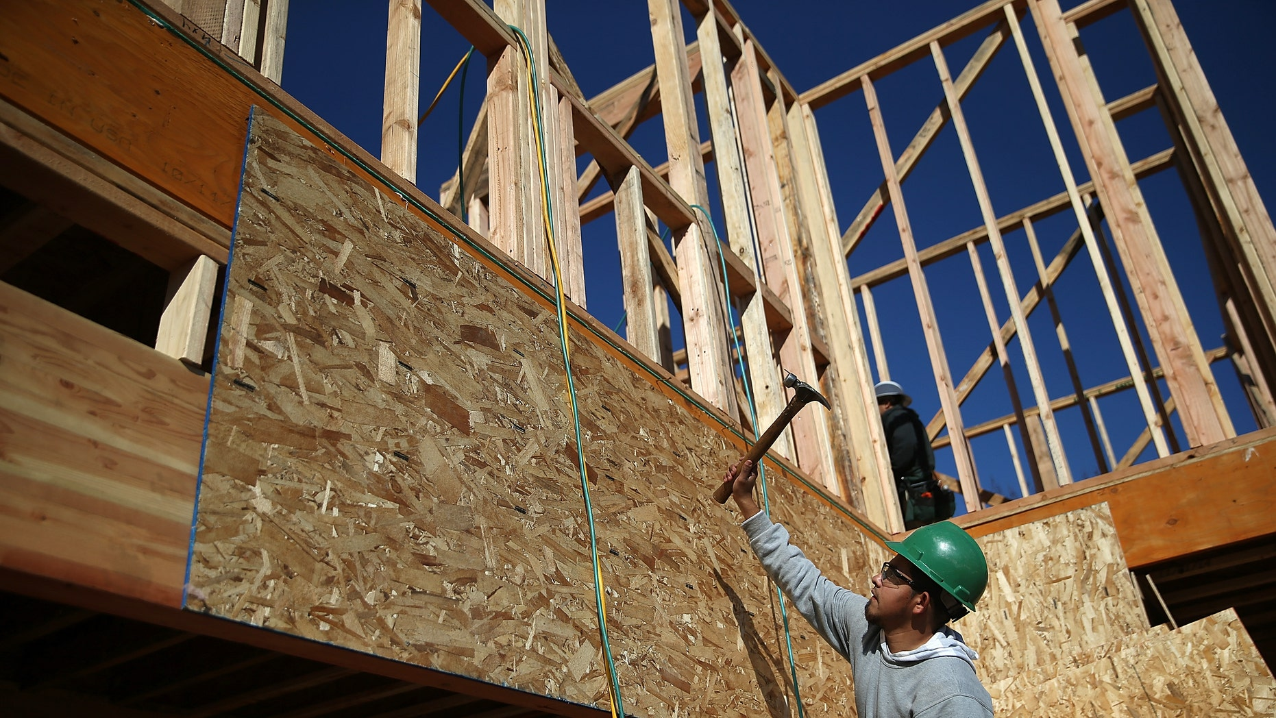 PETALUMA, CA - JANUARY 21:  A worker hammers nails as he builds a new home on January 21, 2015 in Petaluma, California. According to a Commerce Department report, construction of new homes increased 4.4 percent in December, pushing building of new homes to the highest level in nine years.  (Photo by Justin Sullivan/Getty Images)