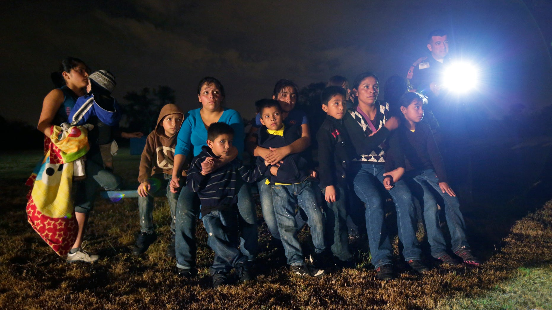 Immigrants from Honduras and El Salvador are stopped in Granjeno, Texas, on June 25, 2014.