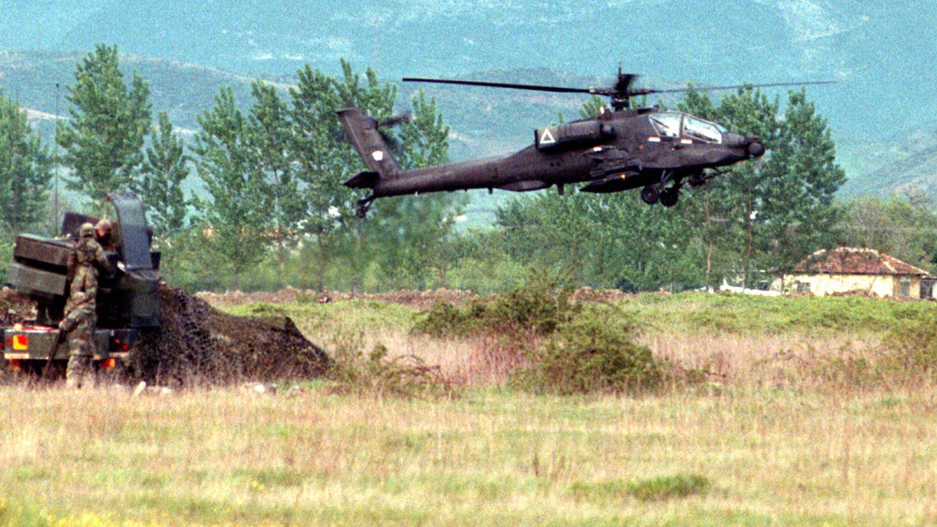 File photo: A U.S. Apache attack helicopter lands at Tirana's Rinas airport after a week of delays. MSP/JRE