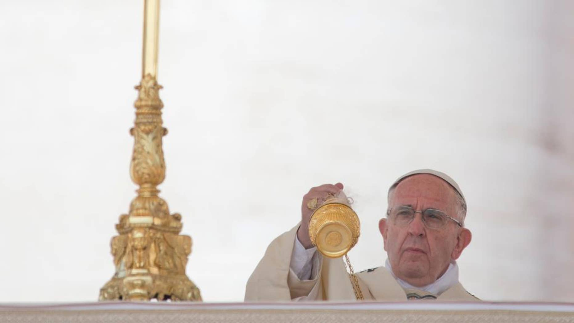 Pope Francis asperses incense as he arrives in St. Peter's Square at the Vatican for a canonization ceremony, Sunday, June 5, 2016. Pope Francis has canonized Elizabeth Hesselblad, a Lutheran convert who hid Jews during World War II and Stanislaus, the founder of the first men's religious order dedicated to the immaculate conception. (AP Photo/Alessandra Tarantino)