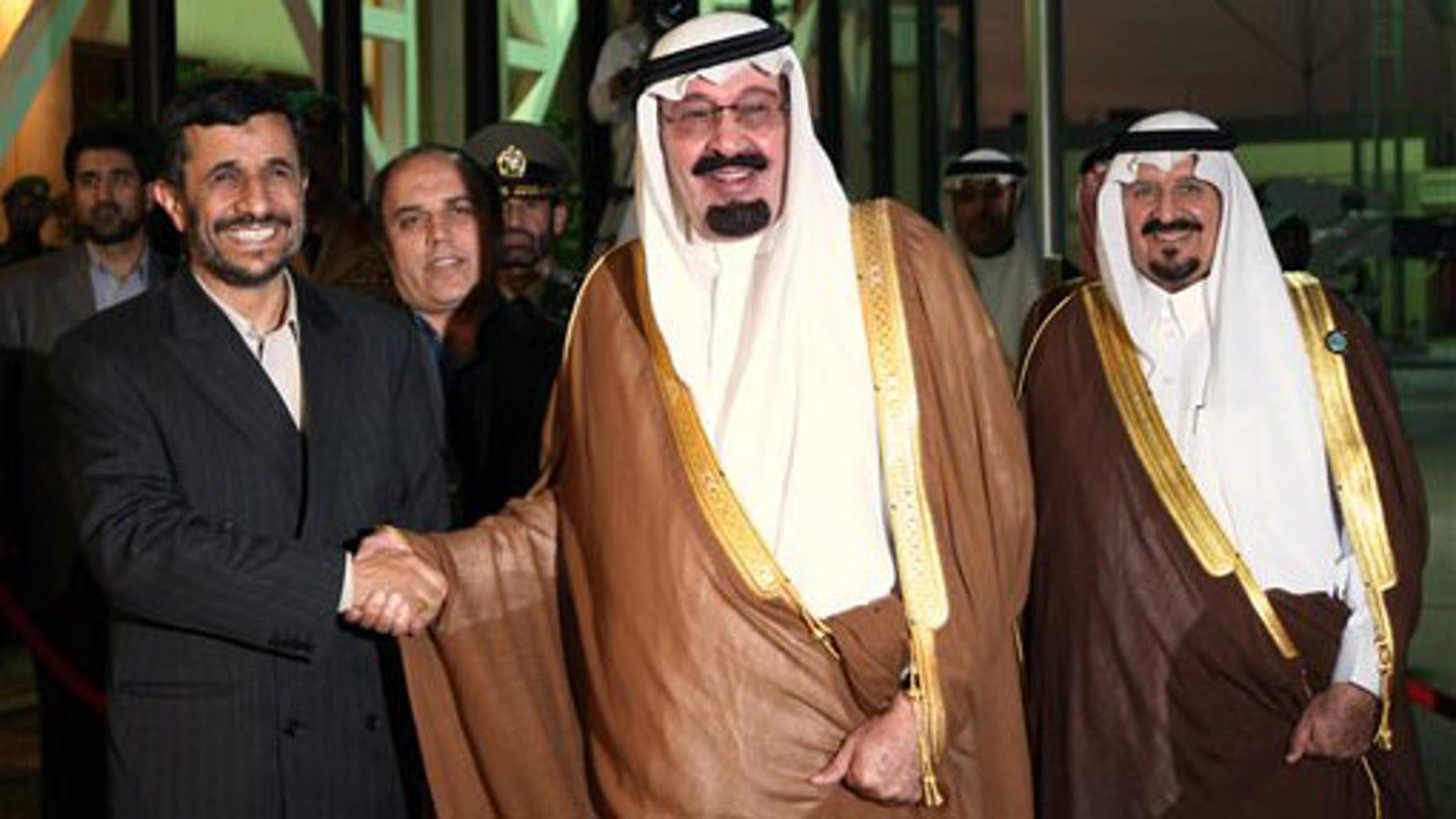 Nov. 2007: Saudi Arabia's King Abdullah, middle, shakes hands with Iran's President Mahmoud Ahmadinejad, left, as Crown Prince Sultan looks on at Riyadh airport.