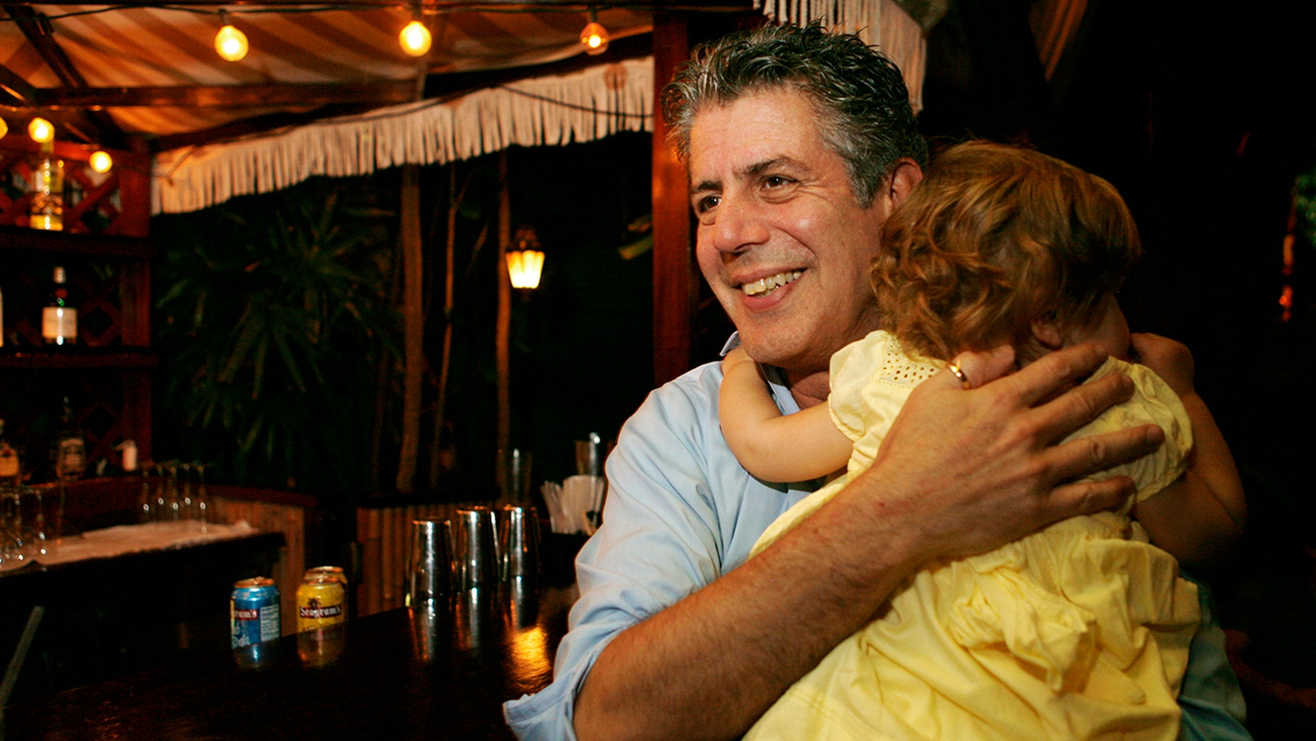 ** FOR USE WITH AP LIFESTYLES ** Chef Anthony Bourdain holds his daughter Ariane in Miami Beach, Wednesday, Nov. 12, 2008. (AP Photo/Lynne Sladky)