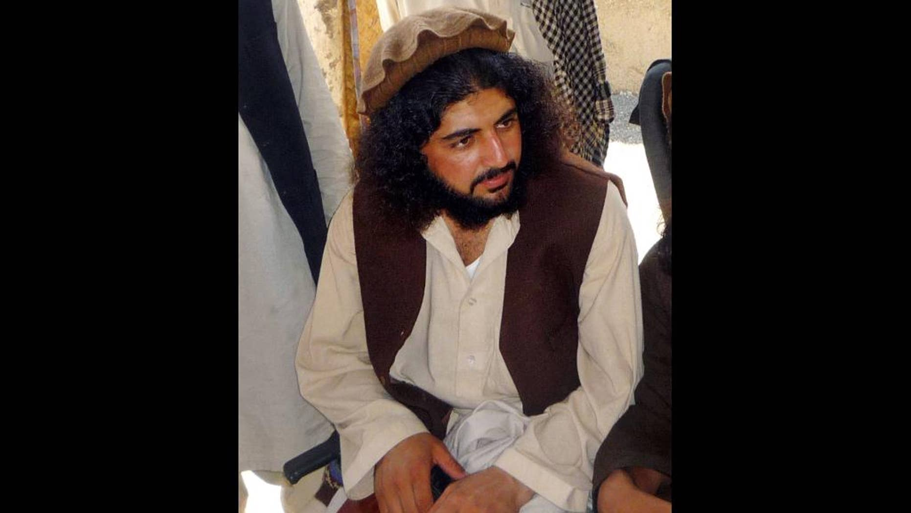 FILE - In this Oct. 4, 2009 file photo, Pakistani Taliban commander Latif Mehsud sits with fellows in Sararogha in south Waziristan in Pakistan. The U.S. military in Afghanistan has handed over three Pakistani detainees to Islamabad, including one who Pakistani intelligence officers said is a senior Taliban commander long wanted by the Pakistani government. The transfer of Mehsud, a close confidante of the former head of the Pakistani Taliban, underlines the improving relations between the U.S., Pakistan and Afghanistan.  (AP Photo/Ishtiaq Mahsud, File)