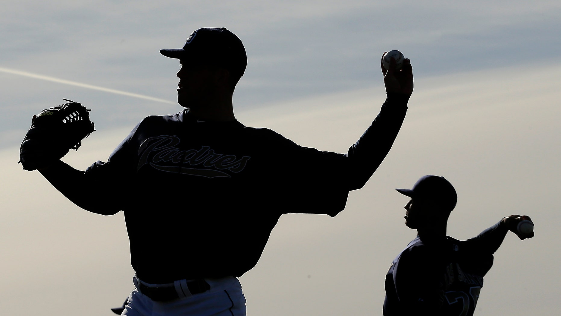 San Diego Padres pitchers Clayton Richard, left, and Fautino De Los Santos throw during a spring training baseball workout on Friday, Feb. 15, 2013, in Peoria, Ariz. (AP Photo/Charlie Riedel)