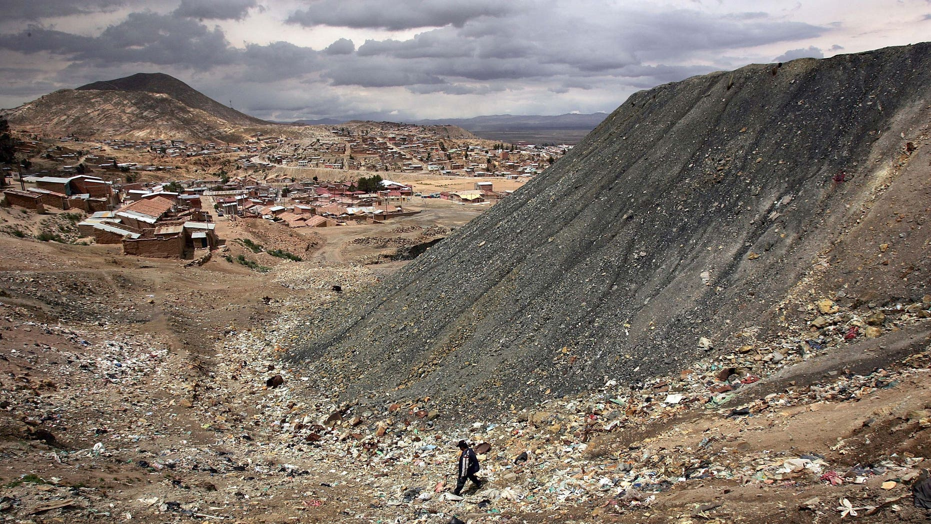 ORURO, BOLIVIA - DECEMBER 14:  A miner walks past a mountain of deposits from the San Jose Mine December 14, 2005 in Oruro, Bolivia. Miners, a crucial sector of Bolivian society, have been a commanding force in the upcoming presidential elections in Bolivia, with most steadfastly behind candidate Evo Morales. Morales, a one time coca farmer and union leader, who offers what may become the most radical vision in Latin America, is leading in the polls for the presidential election which is scheduled to take place on December 18. Washington is paying close attention to the race as fears grow of yet another leftist government.  (Photo by Spencer Platt/Getty Images)