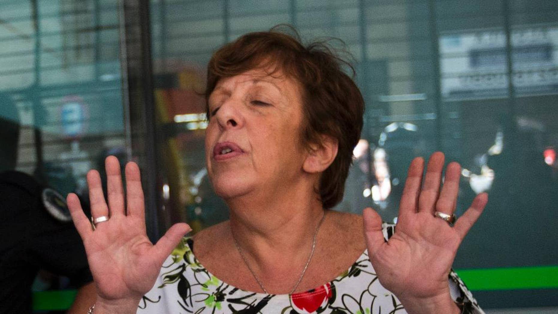"FILE - In this Jan. 22, 2015, file photo, Viviana Fein, who lead the investigation of prosecutor Alberto Nisman's death, speaks with reporters outside her office, in Buenos Aires, Argentina. Fein, who was removed from the investigation of Nisman's mysterious death, had said before that it was likely suicide. But in an interview with local radio station La Red, she acknowledged on Thursday, May 19, 2016, for the first time that it's possible he was ""induced"" to kill himself. (AP Photo/Rodrigo Abd, File)"