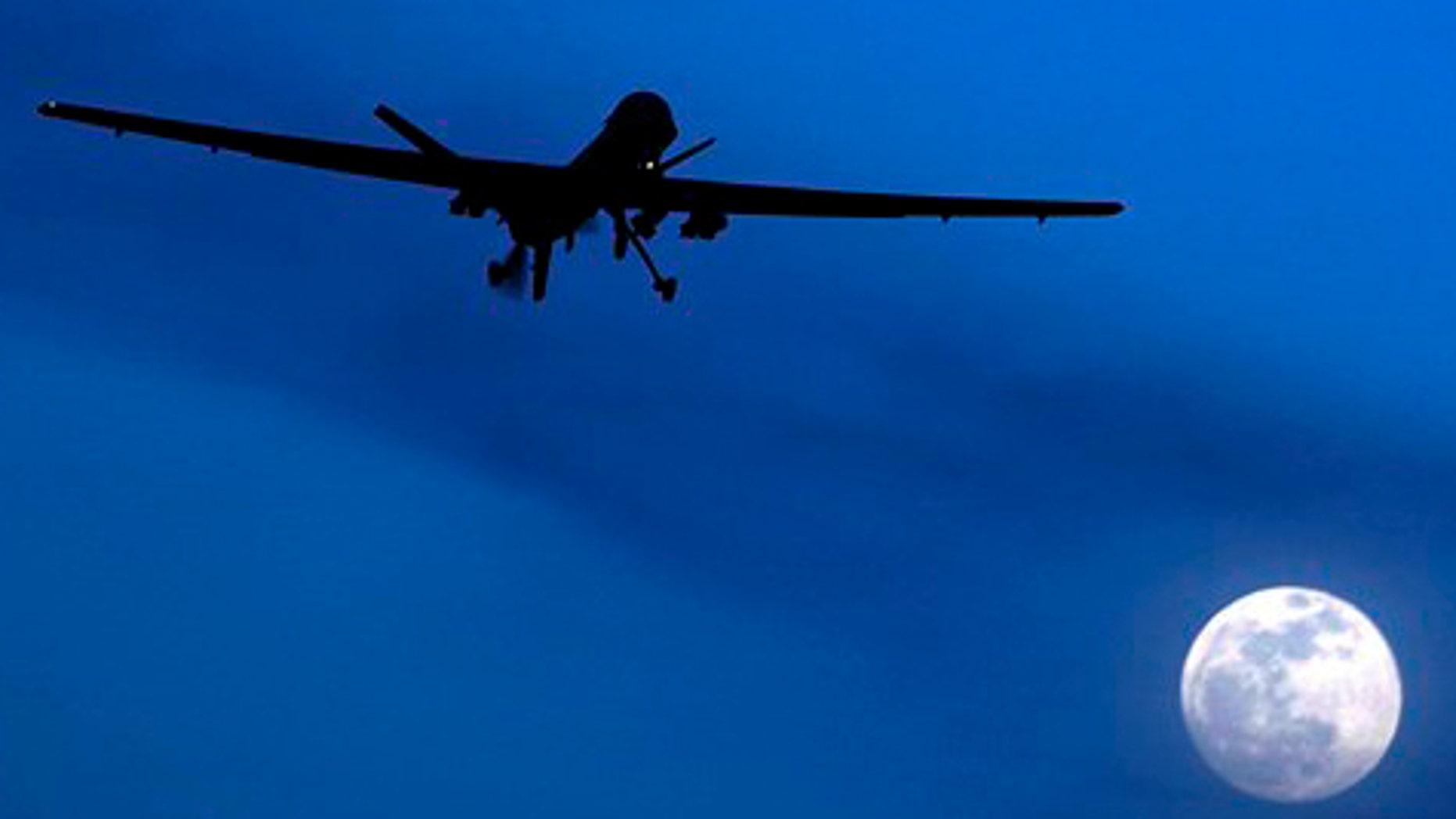 FILE: Jan. 31, 2010: An unmanned U.S. Predator drone flies over Kandahar Air Field on a moon-lit night.