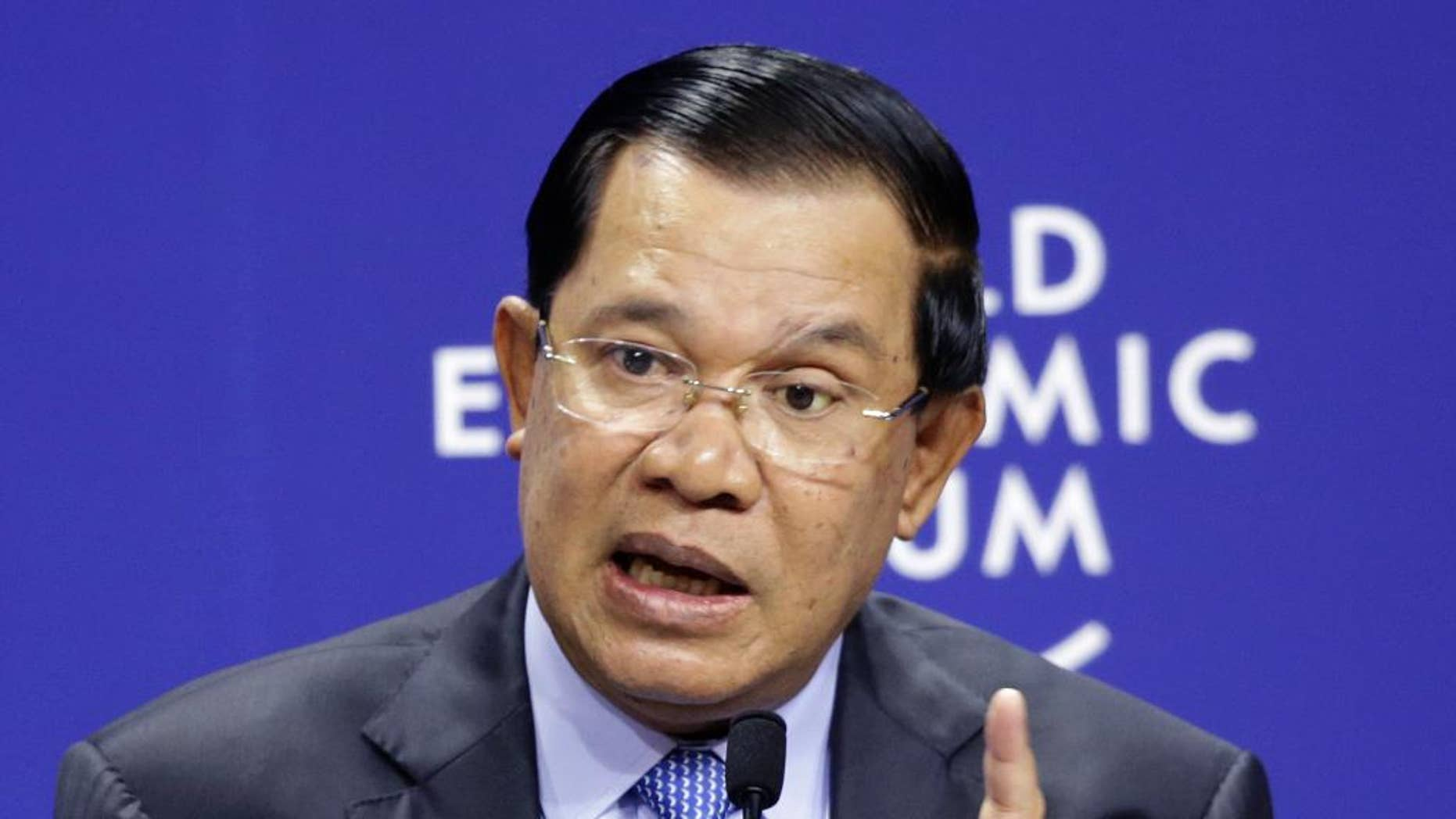"""FILE In this April 21, 2015 file photo, Cambodia's Prime Minister Hun Sen speaks during a session at the World Economic Forum on East Asia in Jakarta, Indonesia. Prime Minister Hun Sen threatened Tuesday, April 12, 2016,  to arrest anyone who repeats opposition accusations that his government used """"fake maps"""" to demarcate the country's border with Vietnam, reviving a campaign of pressure against his foes and critics. (AP Photo/Achmad Ibrahim, File)"""