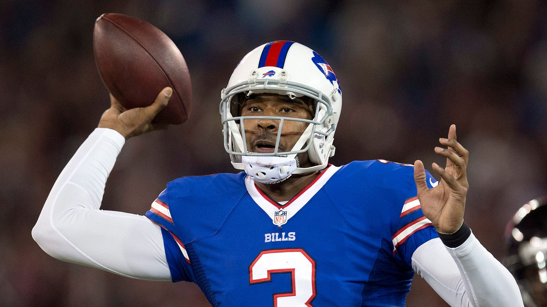 Buffalo Bills quarterback EJ Manuel launches a pass against the Atlanta Falcons during first half NFL football action in Toronto on Sunday Dec. 1, 2013. (AP Photo/The Canadian Press, Frank Gunn)