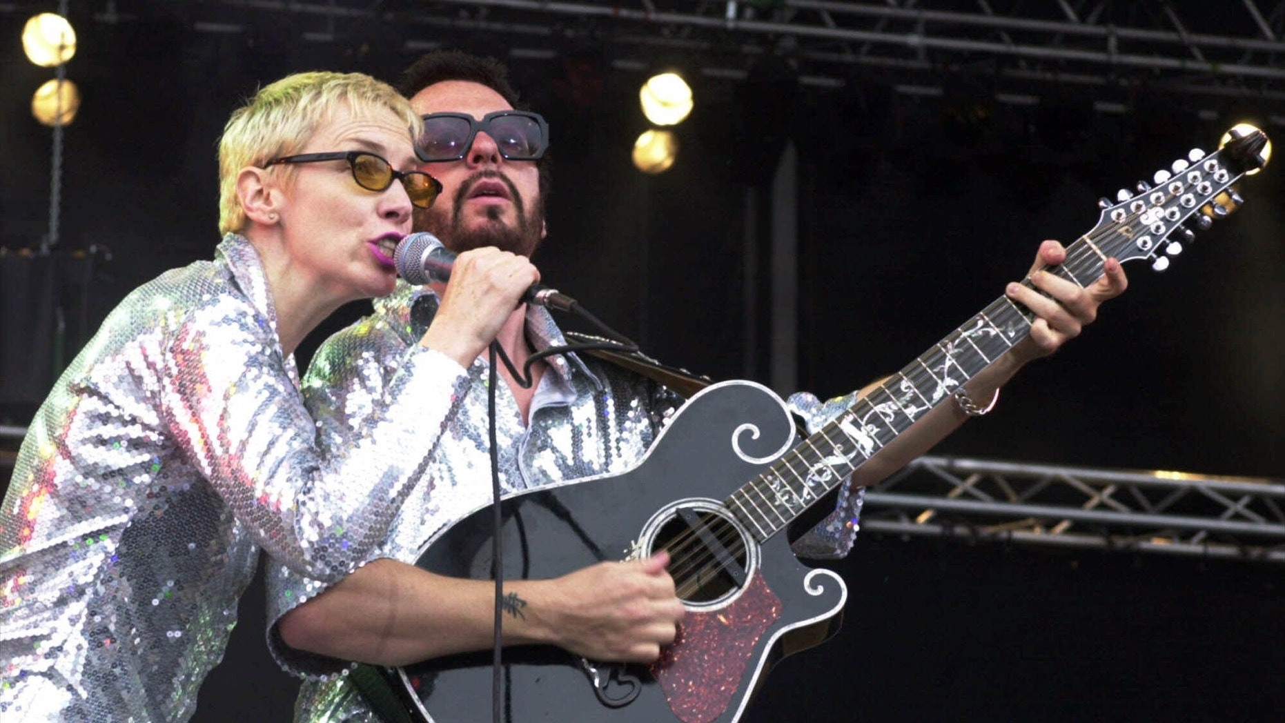 "File- This June 10, 2000, file photo shows Annie Lennox, left, and Dave Stewart as the Eurythmics performing on stage at the Rock at the Ring three-day music festival at the Nuerburgring race circuit in Nuerburg, Germany.  The Eurythmics are reuniting to pay tribute to the Beatles. The Recording Academy announced Monday Jan. 6, 2014, that  Lennox and Stewart will perform as a duo for ""The Night That Changed America: A Grammy Salute To The Beatles."" The event will tape at the Los Angeles Convention Center on Jan. 27, a day after the Grammy Awards. (AP Photo/Pool)"