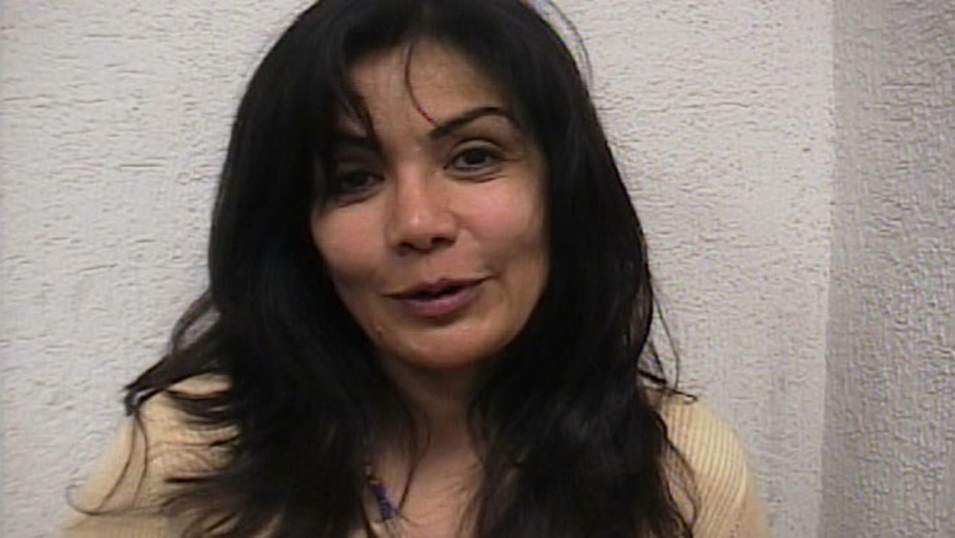 Sandra Avila Beltran smiles after she was arrested by federal agents outside a restaurant in southern Mexico City, Sept. 28, 2007.