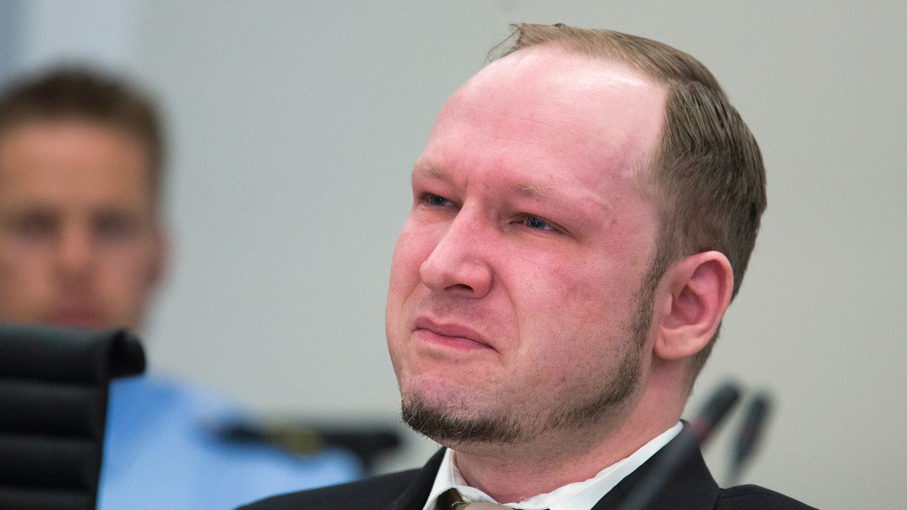 April 16, 2012: Norwegian Anders Behring Breivik, who is facing terrorism and premeditated murder charges, reacts as a video presented by the prosecution is shown in court, Oslo, Norway.