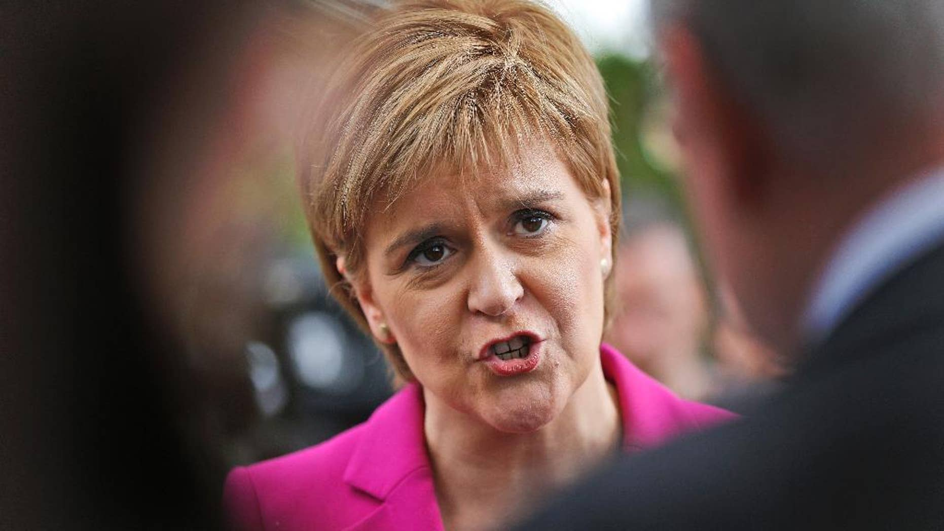 """FILE - In this Monday, May 23, 2016 file photo, Scottish First Minster Nicola Sturgeon talks to journalists after meeting with Plaid Cymru Leader Leanne Wood and Green MP Caroline Lucas, in London. Nicola Sturgeon says in comments that were broadcast on Thursday March 9, 2017, that if Scotland decides on a new independence referendum, it would be """"common sense"""" to hold it in the second half of 2018. (AP Photo/Frank Augstein, File)"""