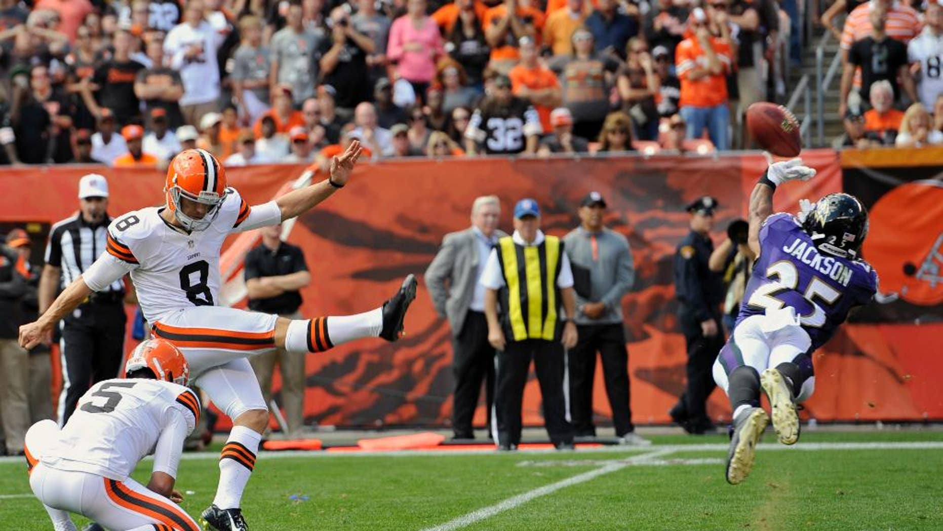 Baltimore Ravens cornerback Asa Jackson (25) blocks a field goal-attempt by Cleveland Browns kicker Billy Cundiff (8) in the fourth quarter of an NFL football game Sunday, Sept. 21, 2014, in Cleveland. (AP Photo/David Richard)
