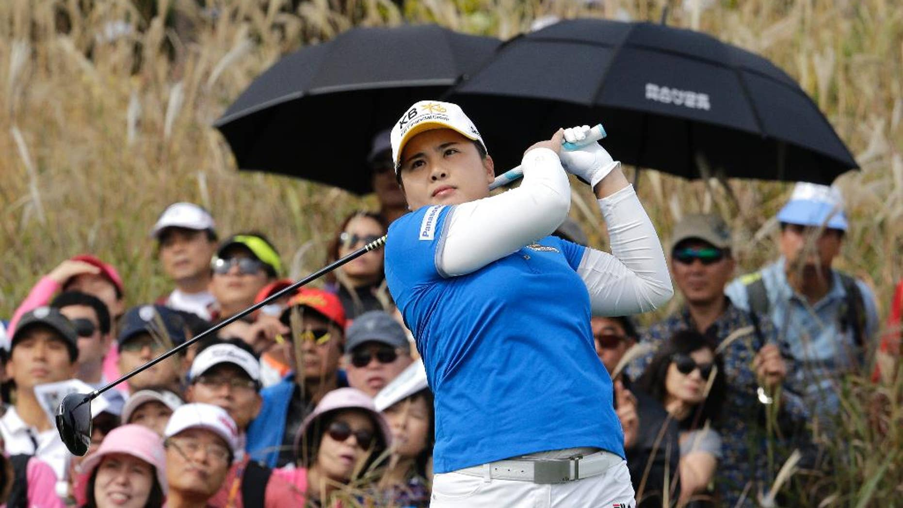 Inbee Park of South Korea watches her shot on the 9th hole during the final round of the KEB Hana Bank Championship golf tournament at Sky72 Golf Club in Incheon, South Korea, Sunday, Oct. 19, 2014.(AP Photo/Ahn Young-joon)