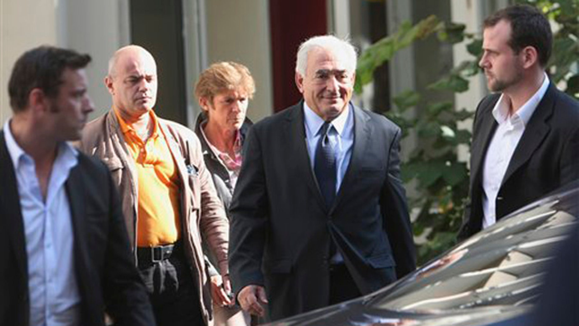 Former IMF chief Dominique Strauss-Kahn, 2nd right, leaves a police station after a one-on-one meeting with writer, Tristane Banon, who accuses him of attempted rape, in Paris, France, Thursday, Sept. 29, 2011.