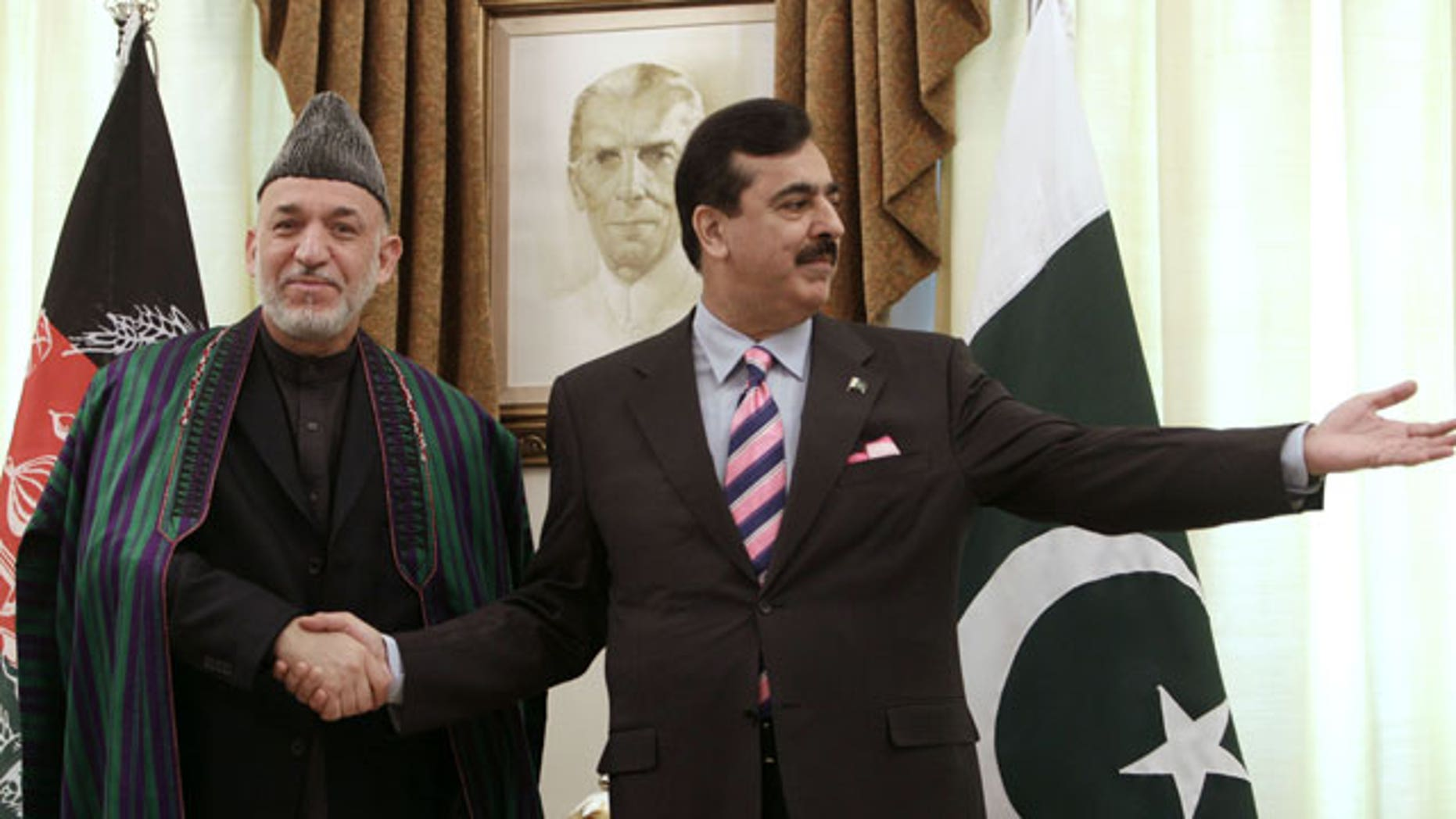 Feb. 16, 2012: Pakistan's Prime Minister Yousaf Raza Gilani, right, invites visiting Afghan President Hamid Karzai for talks upon his arrival at Prime Minister House in Islamabad, Pakistan.