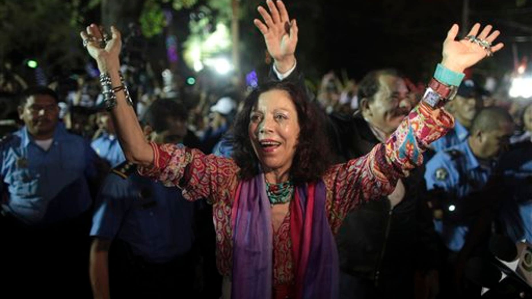 FILE - In this Nov. 8, 2011 file photo, Nicaragua's first lady Rosario Murillo waves to supporters next to her husband, President Daniel Ortega, in Revolution Square in Managua, Nicaragua.