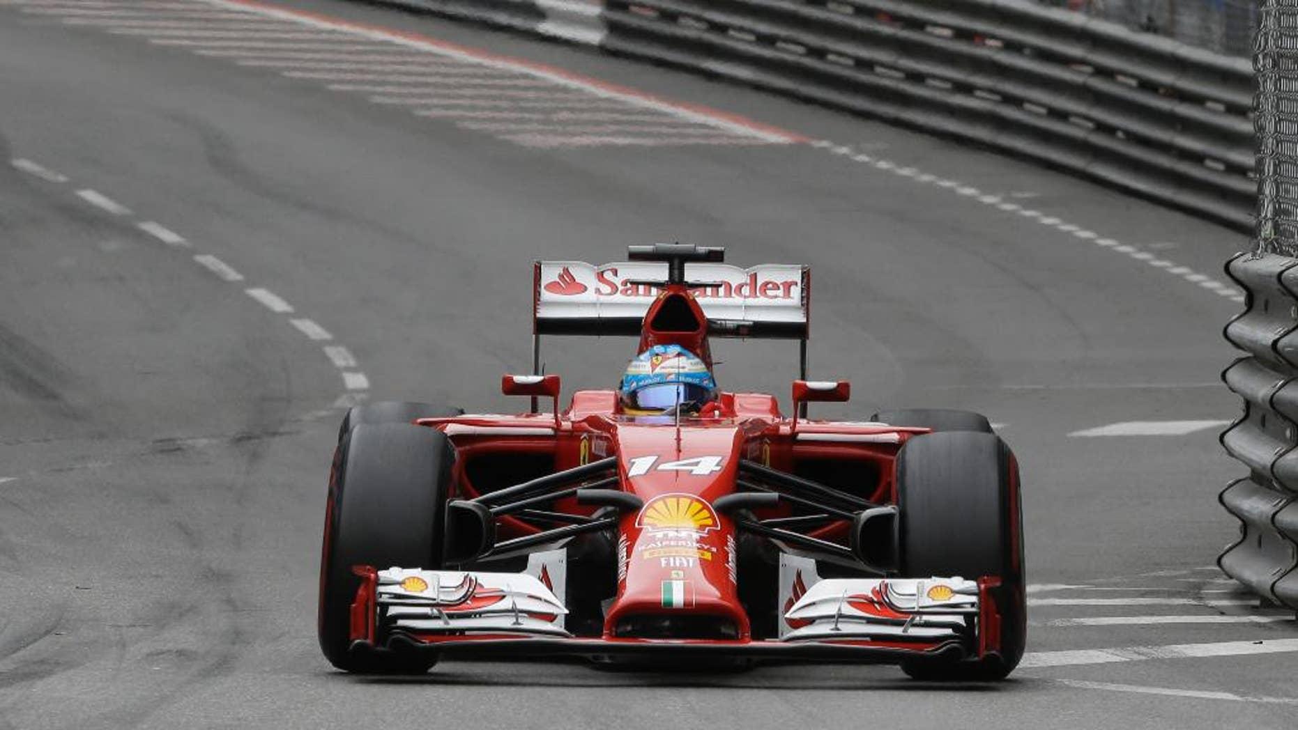Ferrari driver Fernando Alonso of Spain steers his car during the Monaco Formula One Grand Prix, at the Monaco racetrack, in Monaco, Sunday, May 25, 2014. (AP Photo/Luca Bruno)