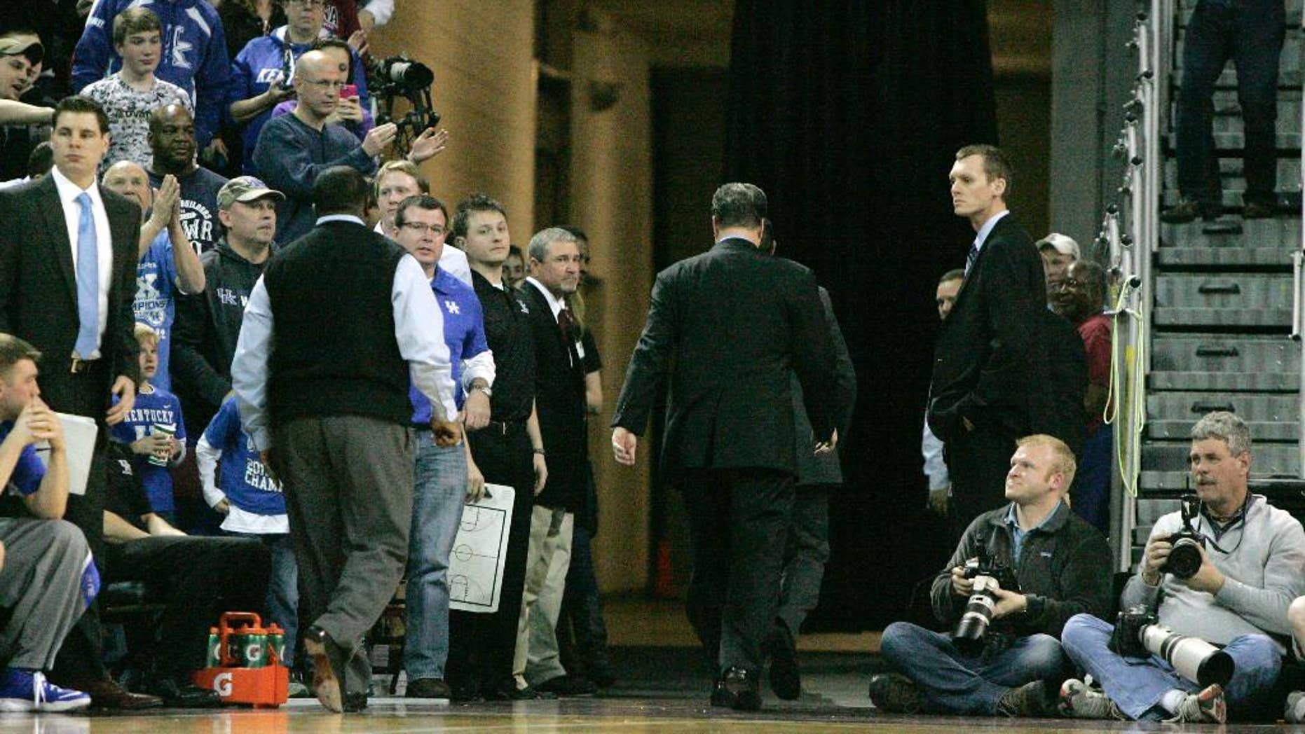 Kentucky coach John Calipari leaves after being ejected during the second half of Kentucky's NCAA college basketball game against South Carolina on Saturday, March 1, 2014, in Columbia, S.C. (AP Photo/Mary Ann Chastain)