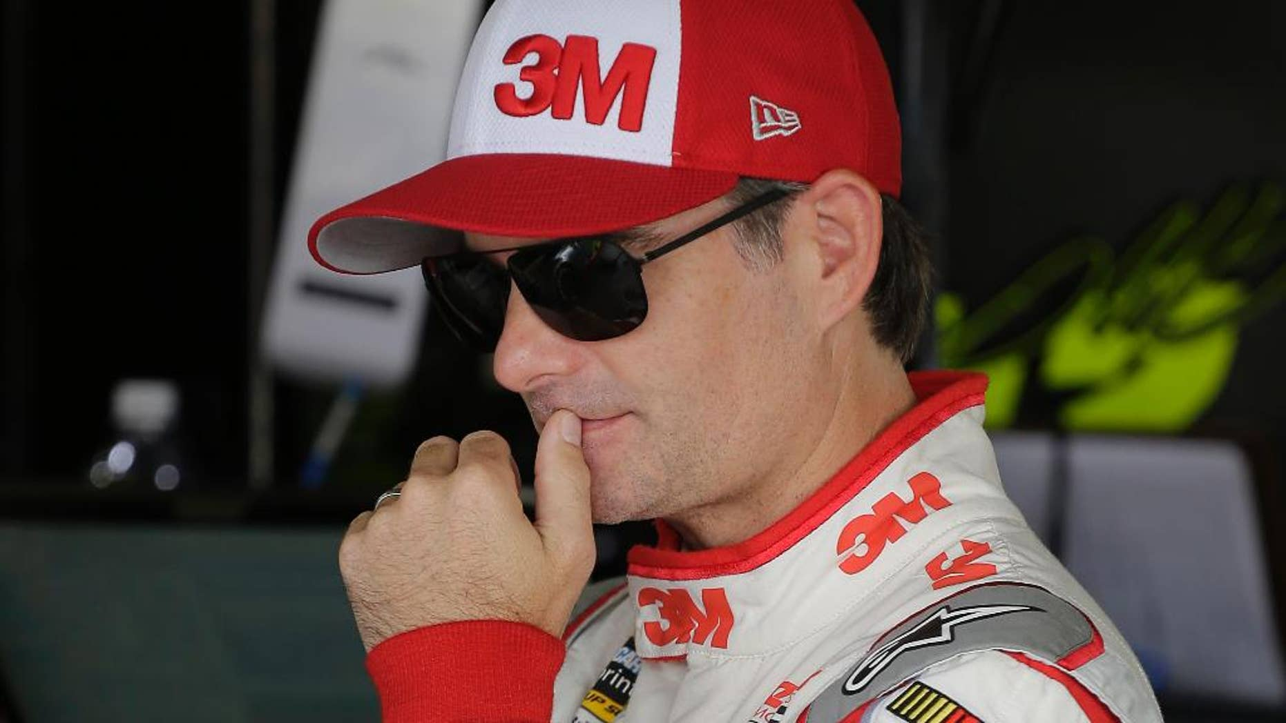 Jeff Gordon stands in the garage before a NASCAR Sprint Cup practice session at Darlington Raceway in Darlington, S.C., Friday, Sept. 4, 2015. (AP Photo/Terry Renna)