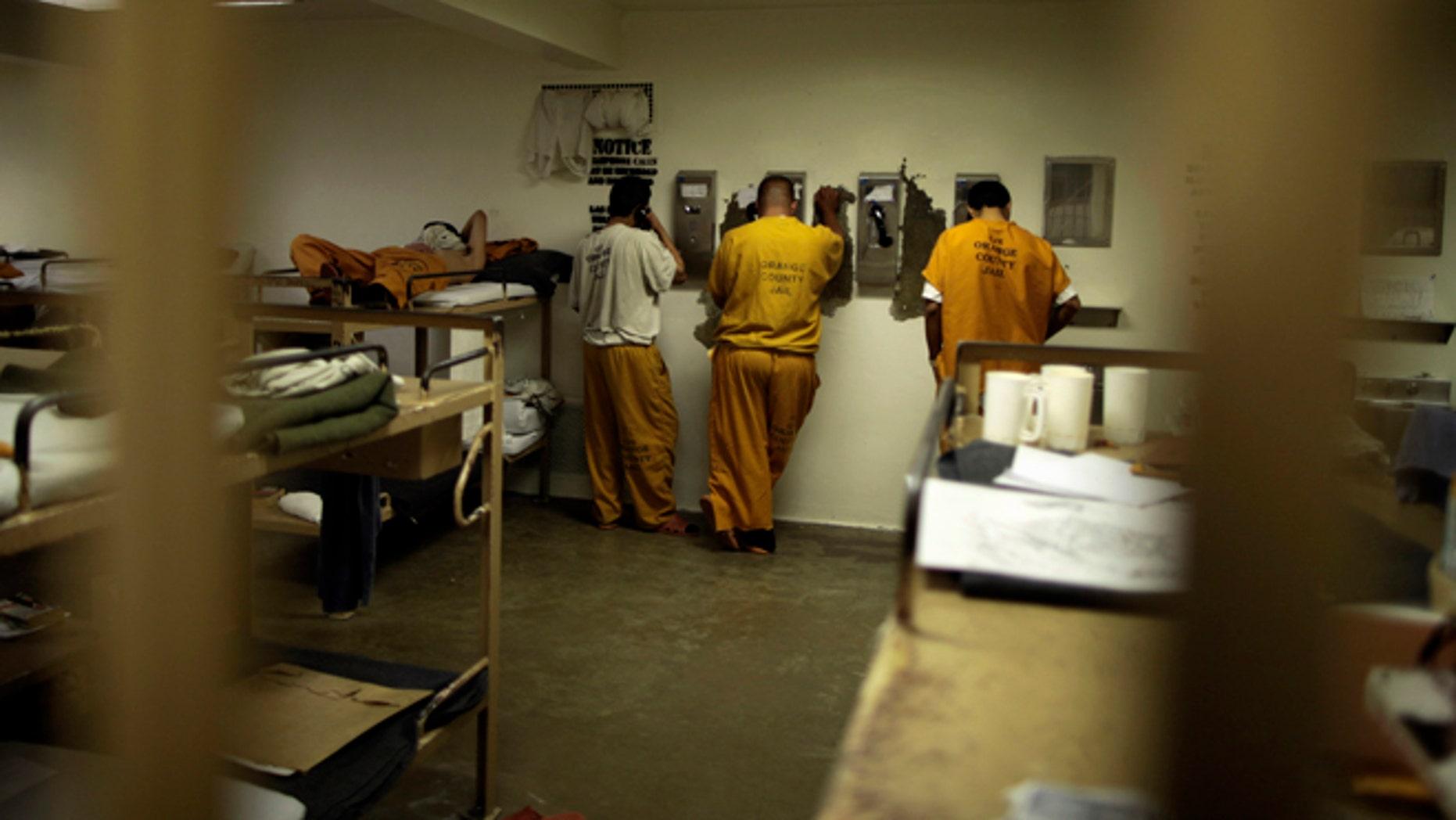 May 24, 2011: Inmates make phone calls from their cell at a county jail in Santa Ana, Calif.