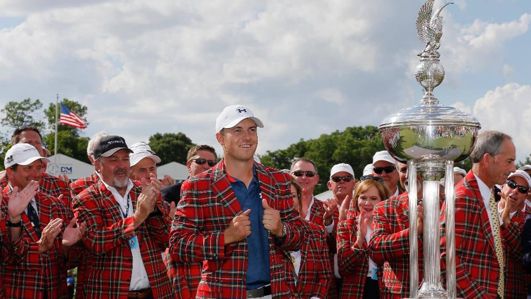 Jordan Spieth poses for photos after being presented with the plead jacket after winning the Dean & DeLuca Invitational golf tournament at Colonial, Sunday, May 29, 2016, in Fort Worth, Texas. (AP Photo/Tony Gutierrez)