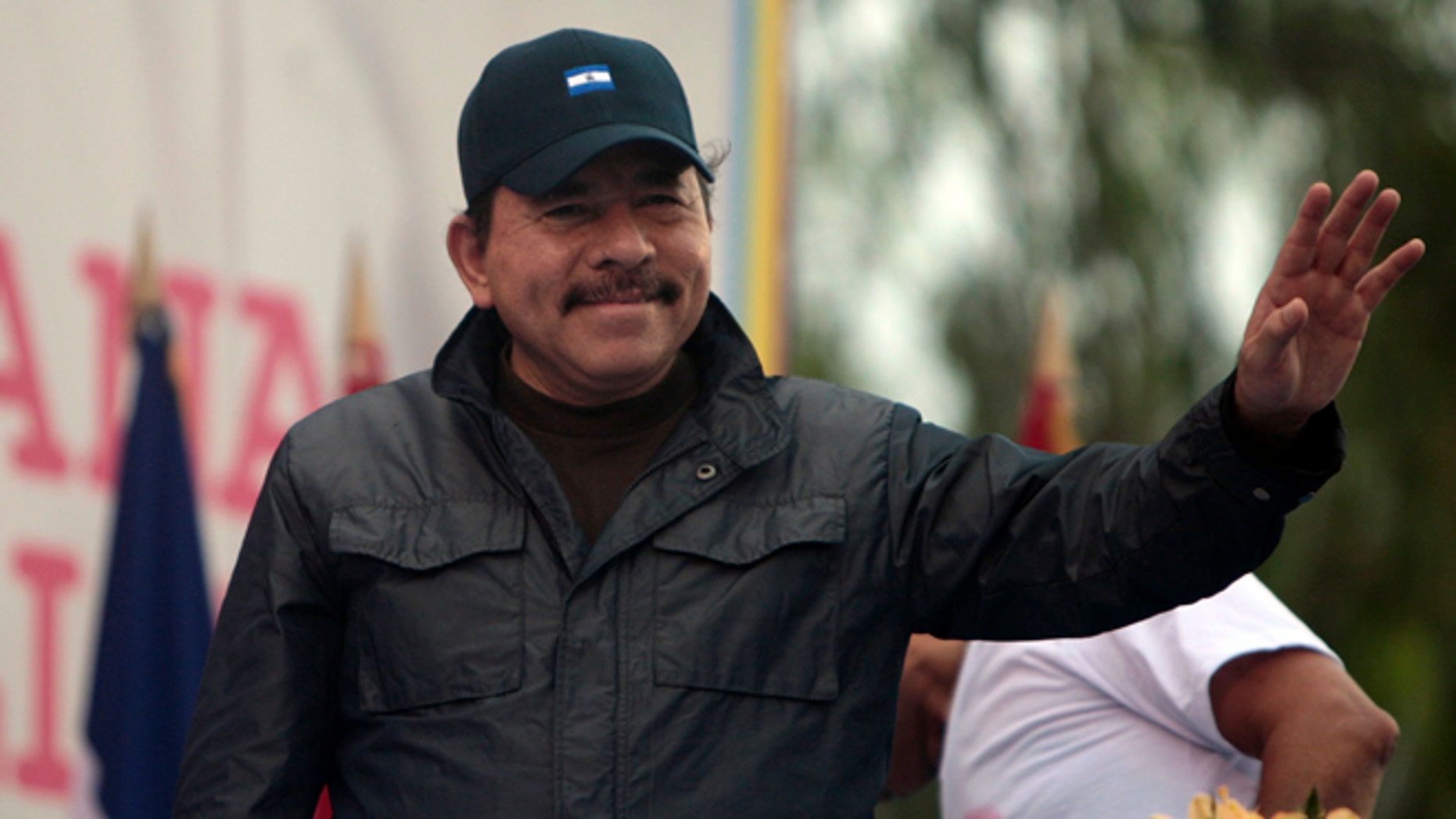 Nicaragua's President Daniel Ortega waves to supporters during an event marking the 32nd anniversary of the Sandinista's withdrawal to Masaya, in Managua, Nicaragua. (AP Photo/Esteban Felix, File)