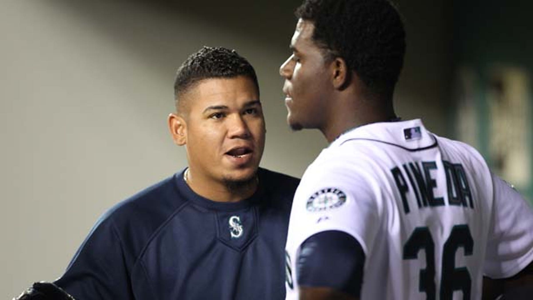 SEATTLE - APRIL 12:  Felix Hernandez #34 of the Seattle Mariners talks with starting pitcher Michael Pineda #36 after he was removed from the game in the eighth inning against the Toronto Blue Jays at Safeco Field on April 12, 2011 in Seattle, Washington. The Mariners defeated the Blue Jays 3-2, and Pineda was credited with the win. (Photo by Otto Greule Jr/Getty Images)