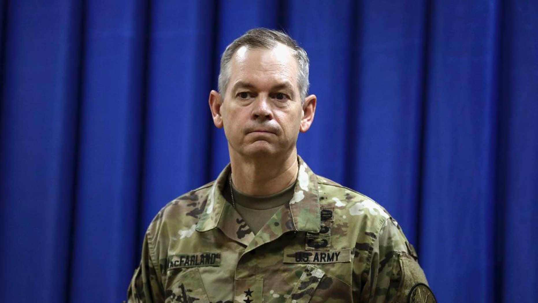 FILE - In this Oct. 1, 2015, file photo, Lt. Gen. Sean MacFarland, the new commander general of the U.S. led coalition in Iraq, attends a news conference at the U.S. Embassy in the heavily fortified Green Zone in Baghdad, Iraq. The military campaigns in Iraq and Syria have taken 45,000 enemy combatants off the battlefield, and reduced the total number of Islamic State fighters to as few as 15,000, the top U.S. commander for the fight against IS said Aug. 10, 2016. MacFarland said that both the number and quality of IS fighters is declining and warned that it is difficult to determine accurate numbers.  (AP Photo/Khalid Mohammed, File)