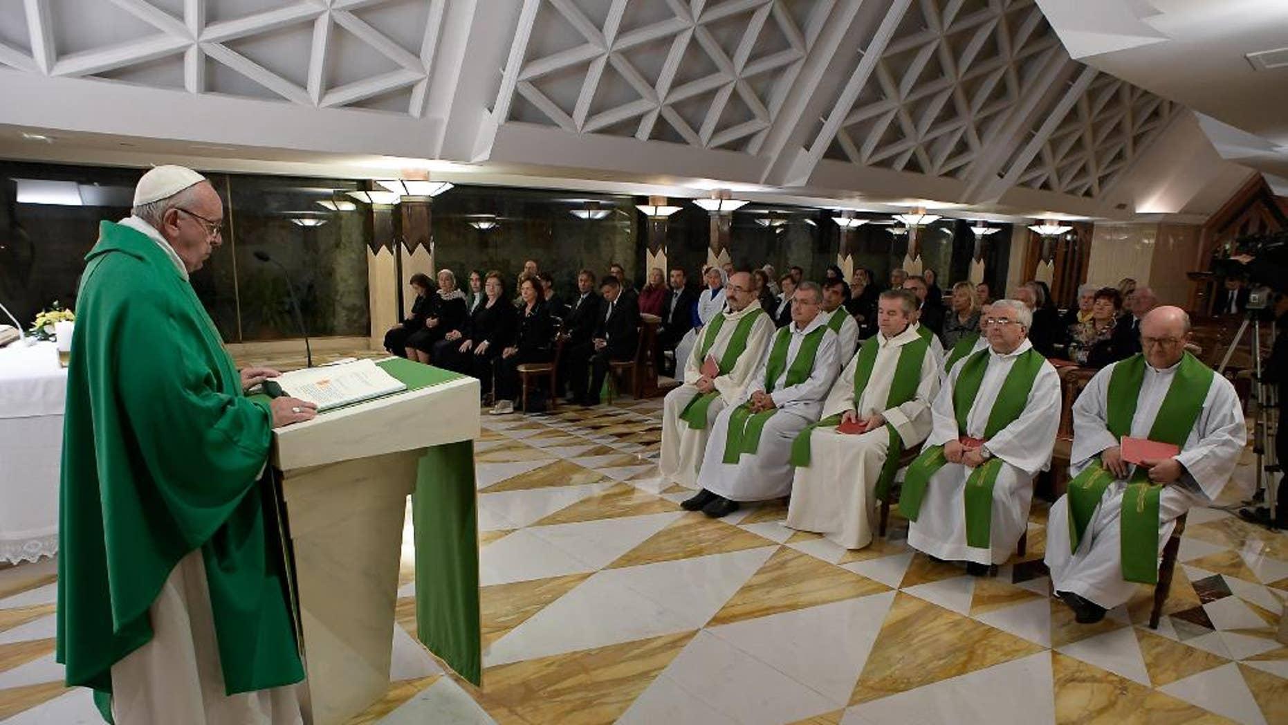 Pope Francis celebrates Mass in the chapel of Santa Marta, at the Vatican, Thursday, Oct. 20, 2016. (L'Osservatore Romano/Pool Photo via AP)