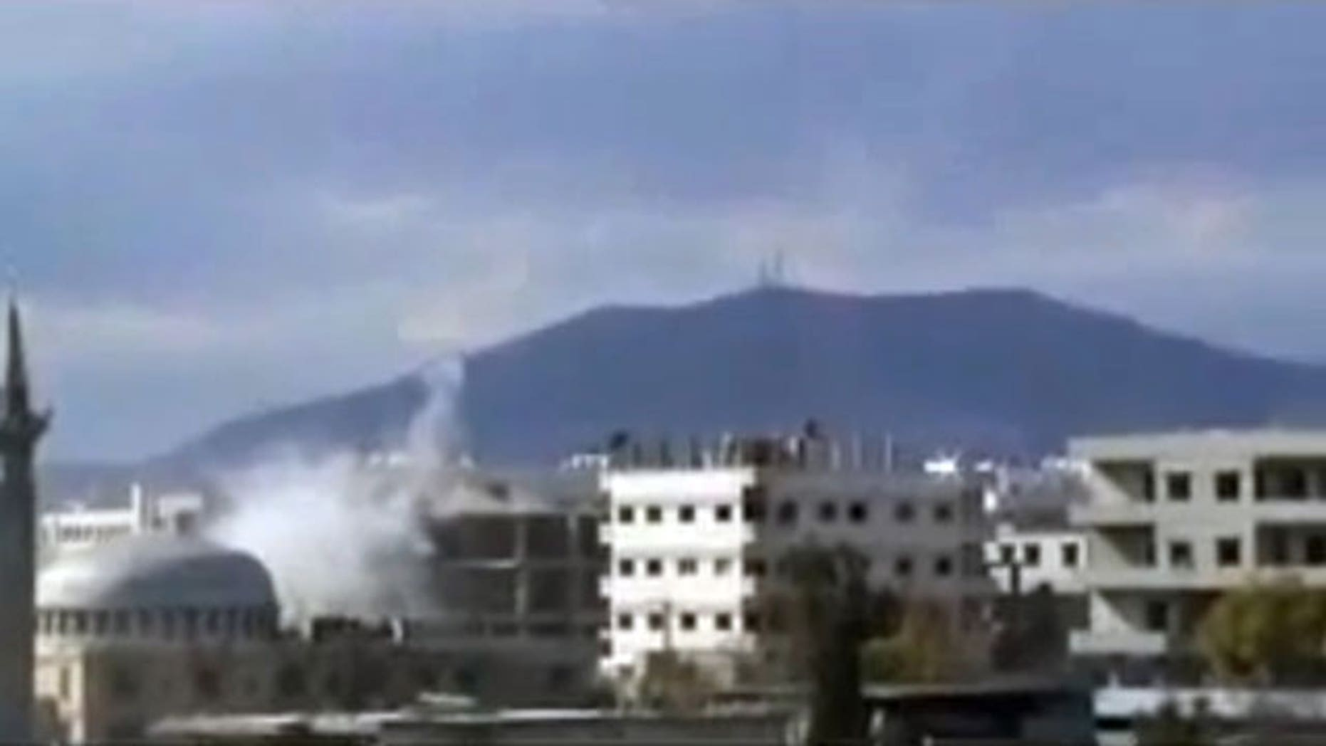 Feb. 6, 2012: This image from amateur video made available by Shaam News Network, purports to show an explosion in Damascus, Syria.