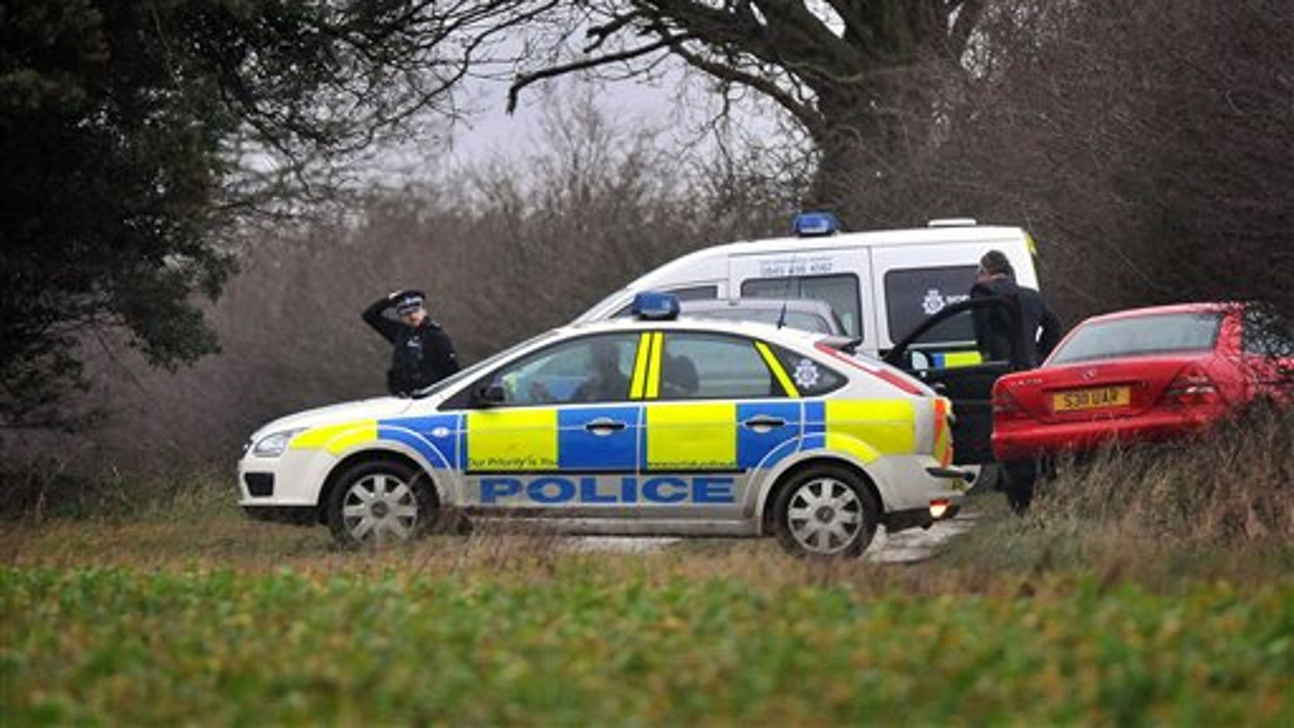 Jan. 3: Police attend the scene following the discovery of human remains on the Queen's Sandringham estate, in Norfolk, England.
