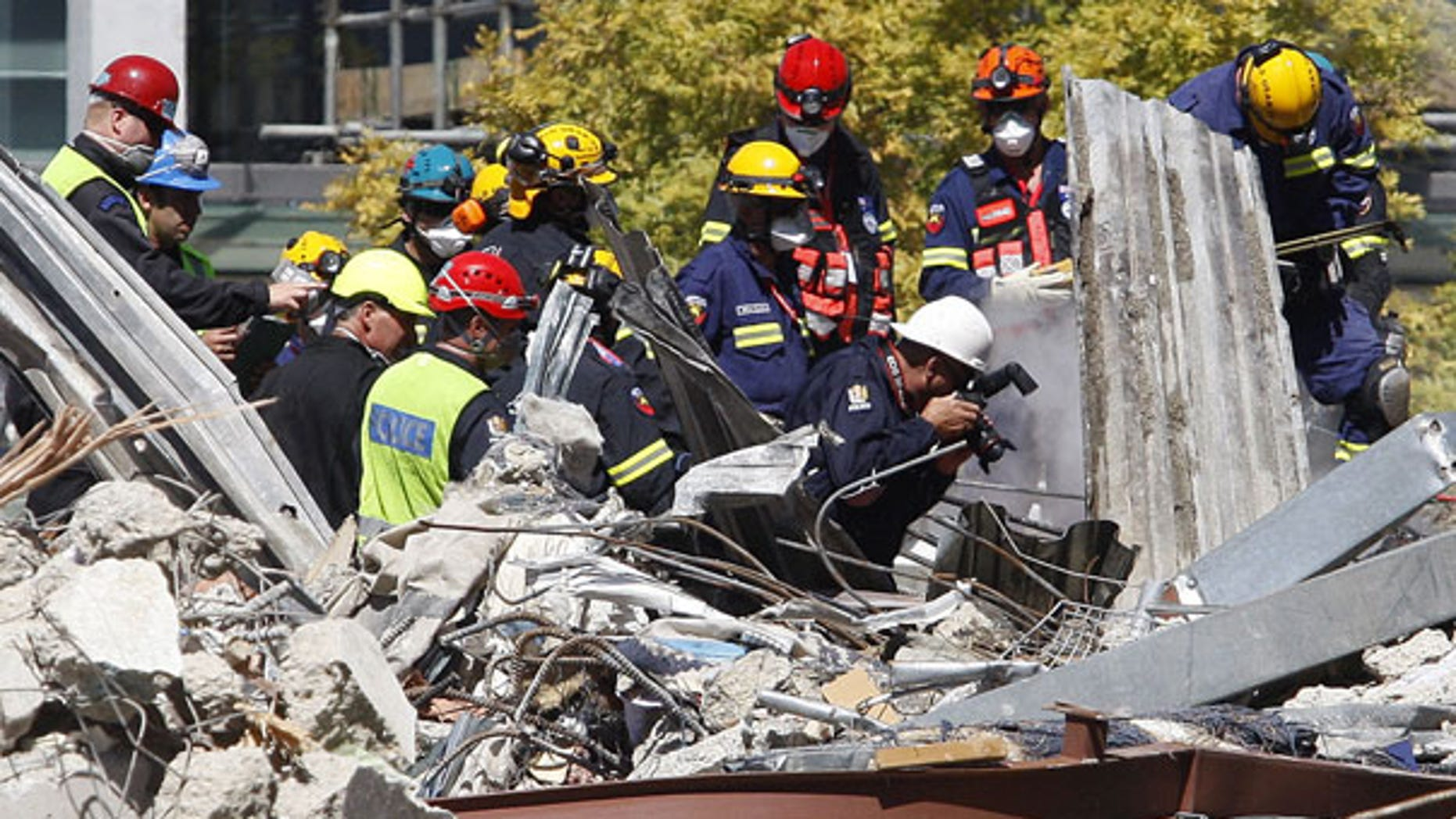 Feb. 24: Emergency services work to remove a body from the site of the CTV building in Christchurch, New Zealand.