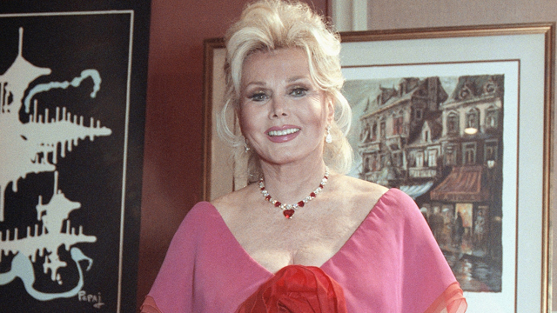June 8, 1990: Zsa Zsa Gabor smiles at a charity auction in Beverly Hills, Calif.
