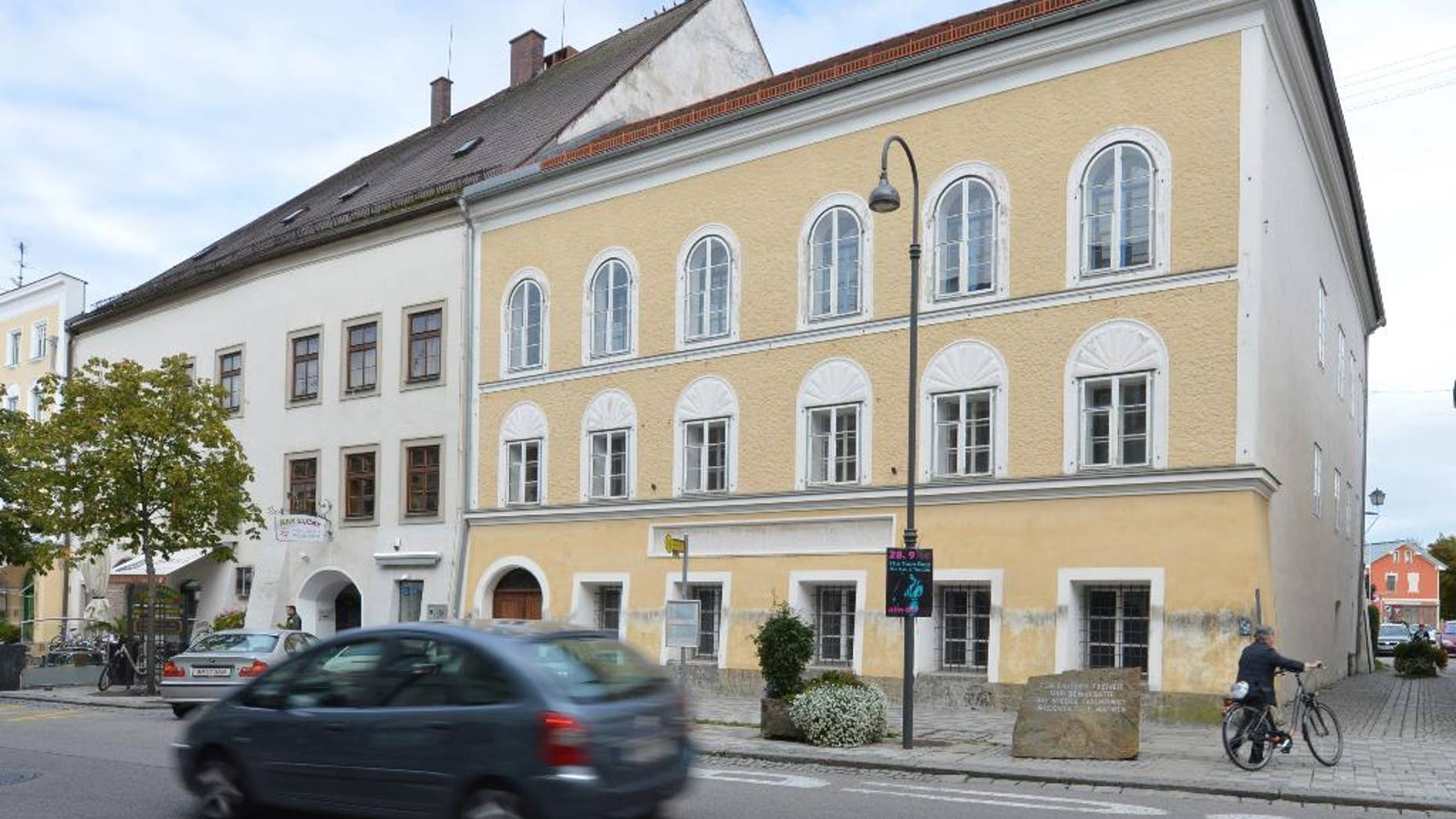FILE - This Sept. 27, 2012 file picture shows an exterior view of Adolf Hitler's birth house , front, in Braunau am Inn, Austria.   Austria's Interior Ministry says the government has drawn up a draft law that would dispossess the owner of the house where Adolf Hitler was born. Tuesday's July 12, 2016  move follows steadfast refusal by house owner Gerlinde Pommer to sell the empty building in the town of Braunau am Inn on the German border. The government has sought ownership so it can take measures to lessen its attraction as a shrine for the Nazi dictator's admirers.  (AP Photo / Kerstin Joensson,file)