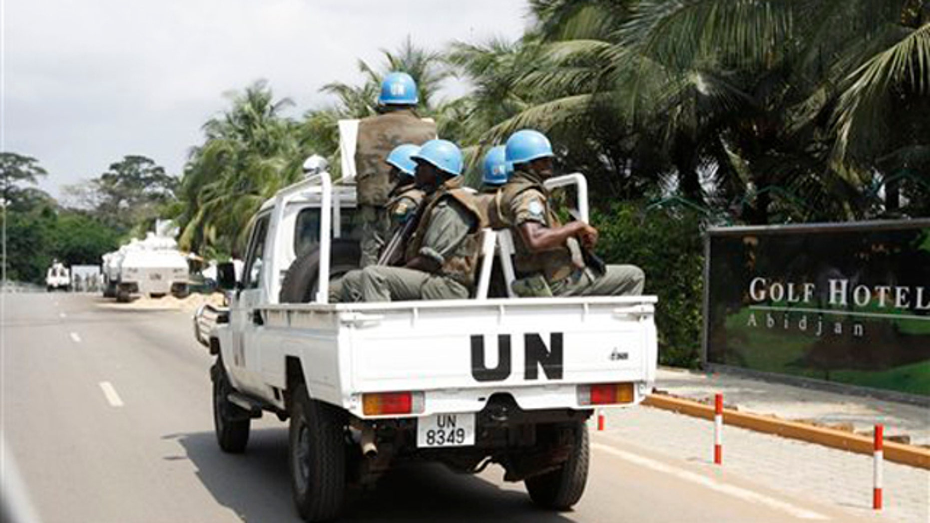 Dec. 23, 2010: U.N. forces patrol outside Golf Hotel in Ivory Coast, Abidjan. The United Nations said that at least 173 people have been killed and dozens of others have gone missing or been tortured following Ivory Coast's disputed presidential election, which has prompted fears of a return to civil war.