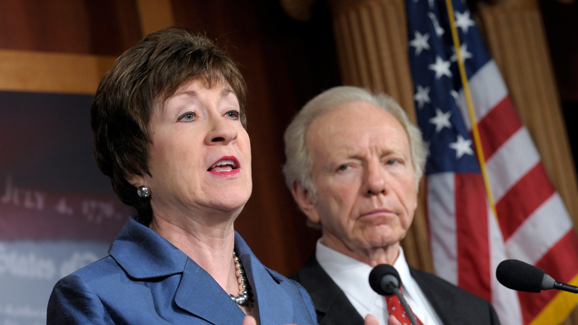 Senate Homeland Security Committee Chairman Sen. Joseph Lieberman, I-Conn. listens at right, as the committee's ranking Republican, Sen. Susan Collins, R-Maine speaks during a news conference on Capitol Hill in Washington, Monday, Dec. 31, 2012, to discuss the committee's report on the security deficiencies at the temporary U.S. Mission in Benghazi, Libya. (AP Photo/Susan Walsh)