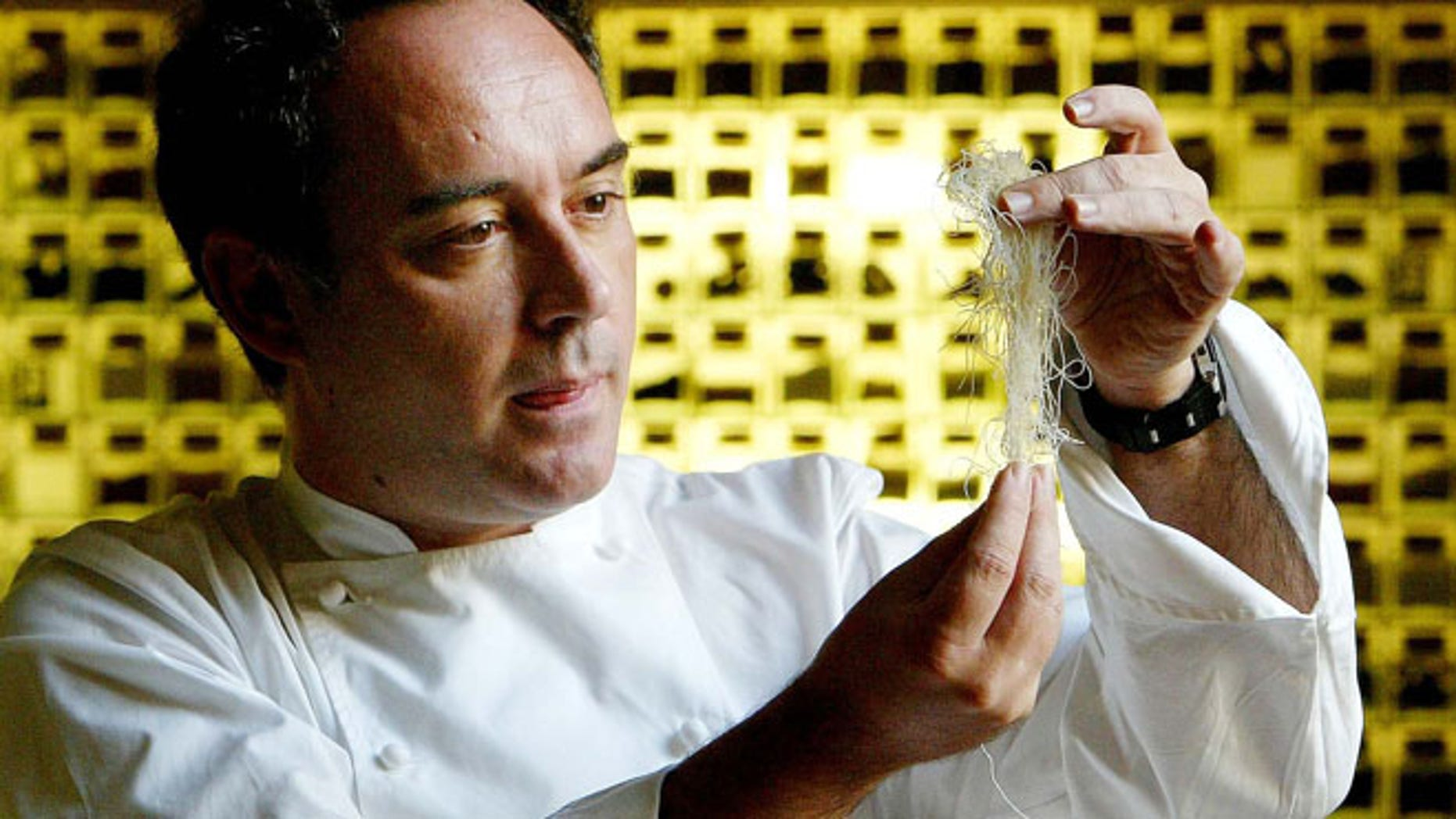 Dec. 5, 2003: Spanish chef Ferran Adria examines ingredients in his kitchen workshop in Barcelona, Spain.